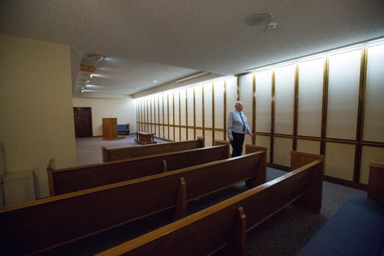 Terry Getz, owner of Getz Funeral Home at 1410 E. Bowman Ave in Las Cruces, walks through the home's chapel on Friday, Aug. 31, 2018.