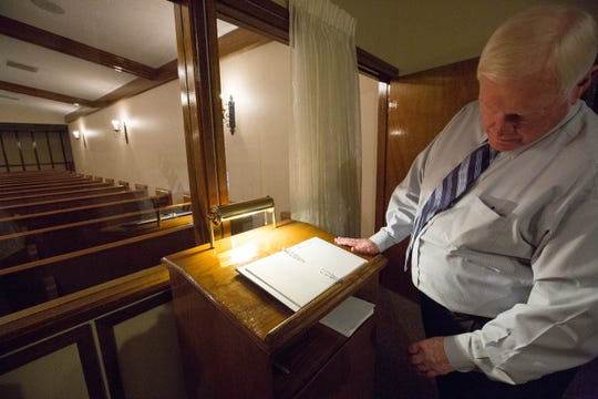 Terry Getz, owner of Getz Funeral home, sets out a guest book Friday, Aug. 31, 2018, at the home's East Bowman Avenue location and explains the processes involved with conducting a funeral.