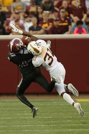 New Mexico State wide receiver Johnathan Boone (13) tries to catch the ball against Minnesota defensive back Kiondre Thomas (31) during the first half of an NCAA college football game Thursday, Aug. 30, 2018, in Minneapolis. (AP Photo/Stacy Bengs)