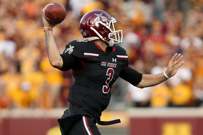 New Mexico State quarterback Matt Romero (3) throws against Minnesota during an NCAA college football game Thursday, Aug. 30, 2018, in Minneapolis. (AP Photo/Stacy Bengs)