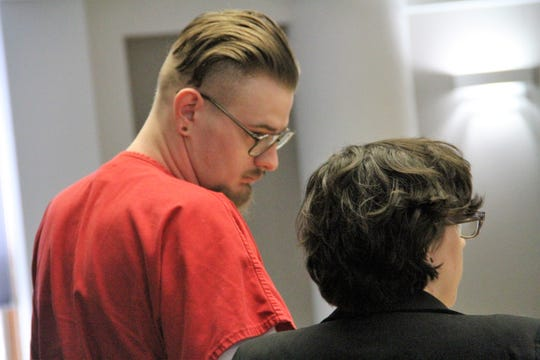 Jared Young, 20, talks to one of his defense attorneys in 12th Judicial District Court during his sentencing hearing Friday for killing David Tally.