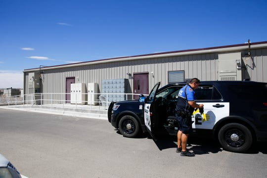 Kris Chavez, a district coordinator officer with Farmington Police Department drops off an inebriated subject, Thursday, Aug. 30, 2018 at the Sobering Center in Farmington.