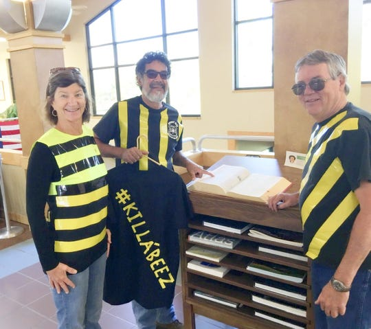 A costumed Ruidoso Councilor Rifle Salas, center, his wife Shippen and Councilor John Cornelius did a little prepping at the public library for last year's adult spelling bee.