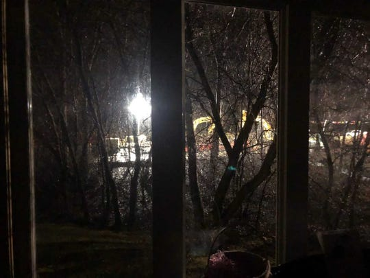 A photo taken from inside the Sherwoods' home shows a DTE crew working through the night on the pipeline bypass project on the east side of the family's property.