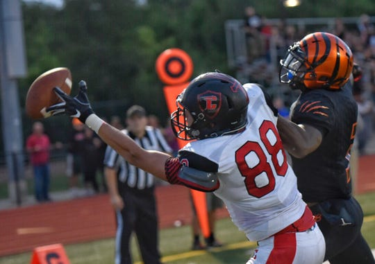 The ball eludes the finger tips of Churchill tight end Joel Forgacs in Friday's KLAA East Division game at Belleville.