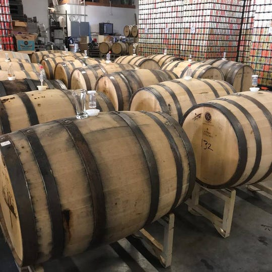 Beer ages in barrels last year at Right Brain Brewery in Traverse City. The brewery will attend Brewed in Michigan for its fifth time on Sept. 14 in Milford Township.