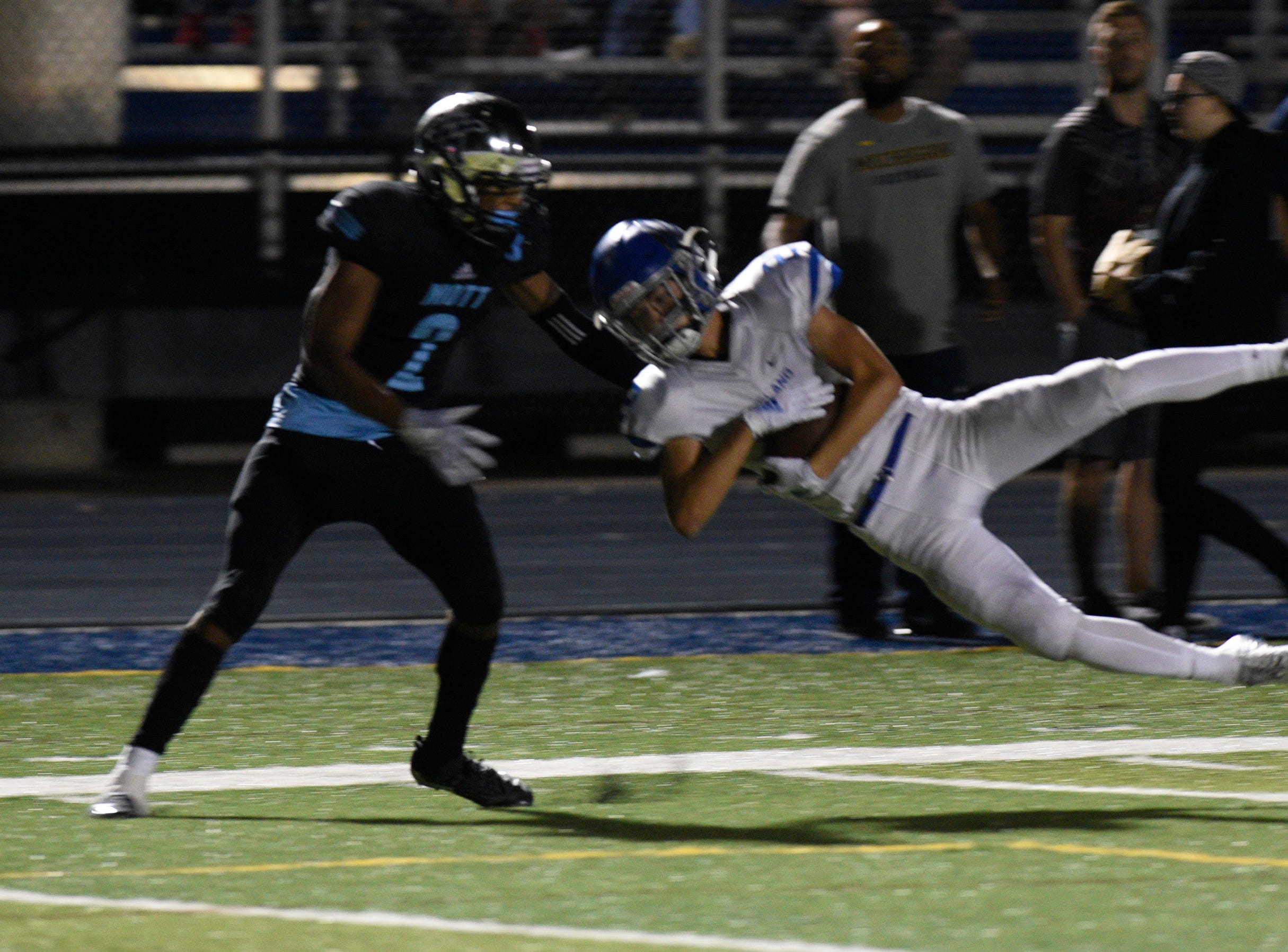 lakeland's Leo Skupin intercepts a pass intended for Waterford Mott's Kamariell Manley.