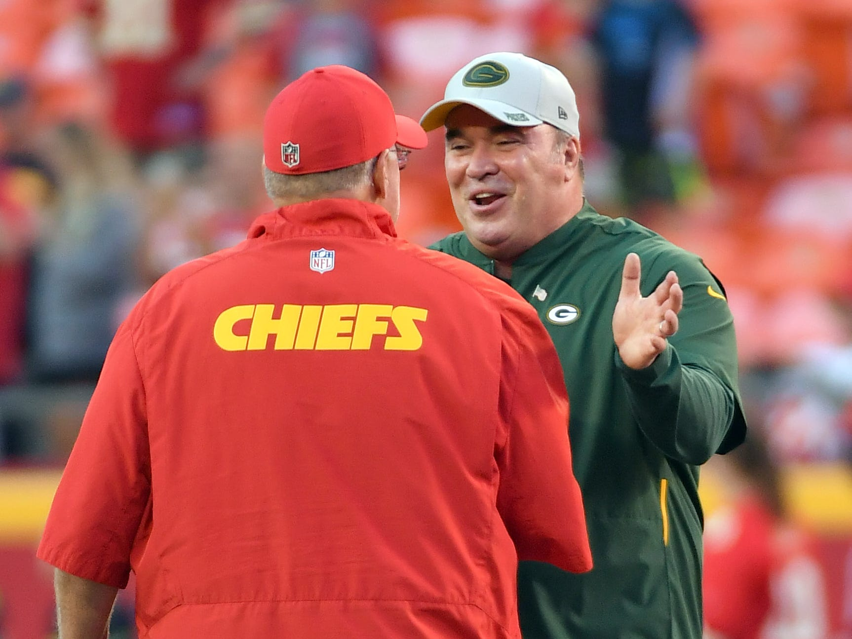 Aug 30, 2018; Kansas City, MO, USA; Green Bay Packers head coach Mike McCarthy talks with Kansas City Chiefs head coach Andy Reid before the game at Arrowhead Stadium.