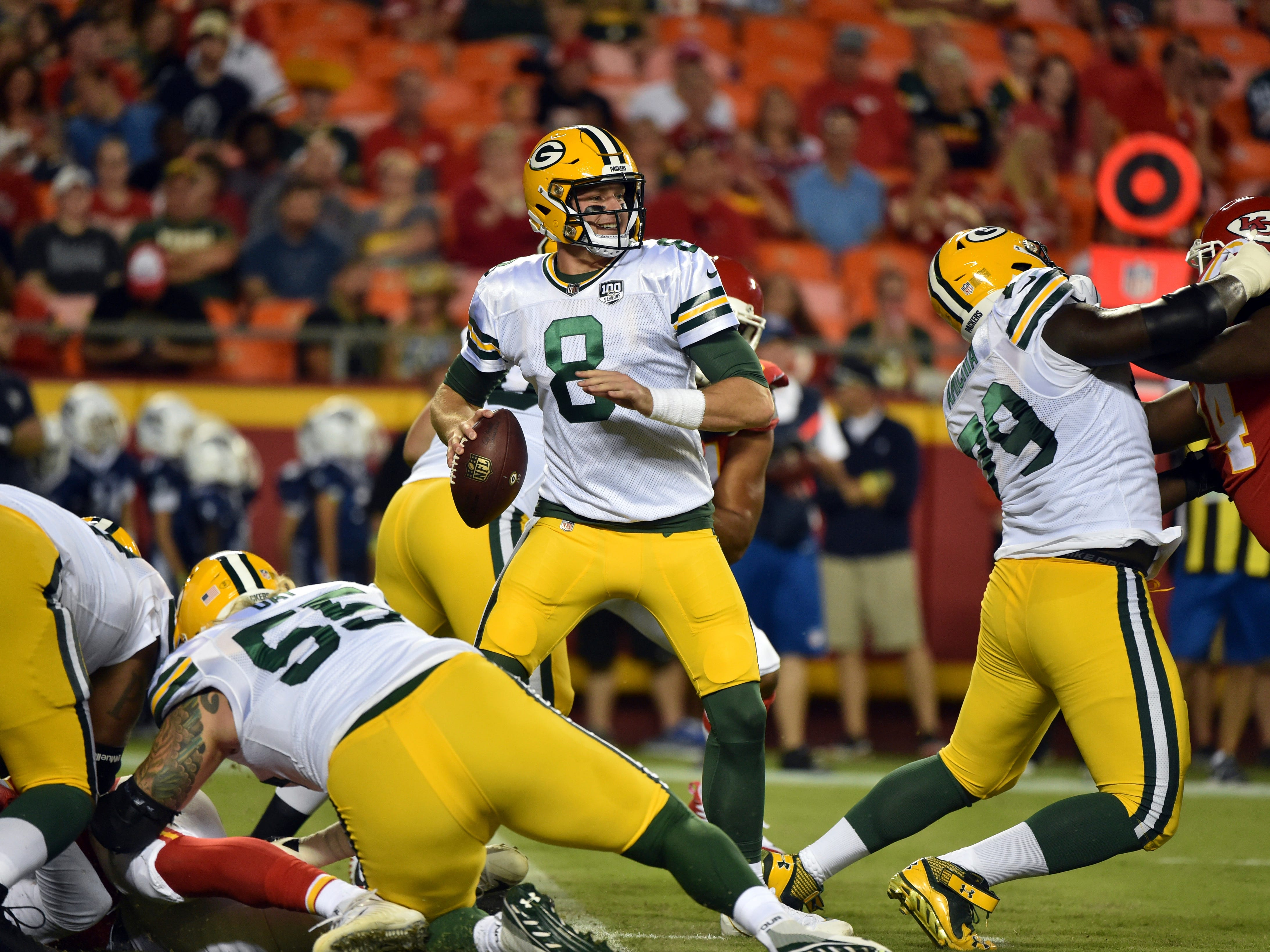 Green Bay Packers quarterback Tim Boyle (8) looks to throw during the first half of an NFL preseason football game against the Kansas City Chiefs in Kansas City, Mo., Thursday, Aug. 30, 2018.