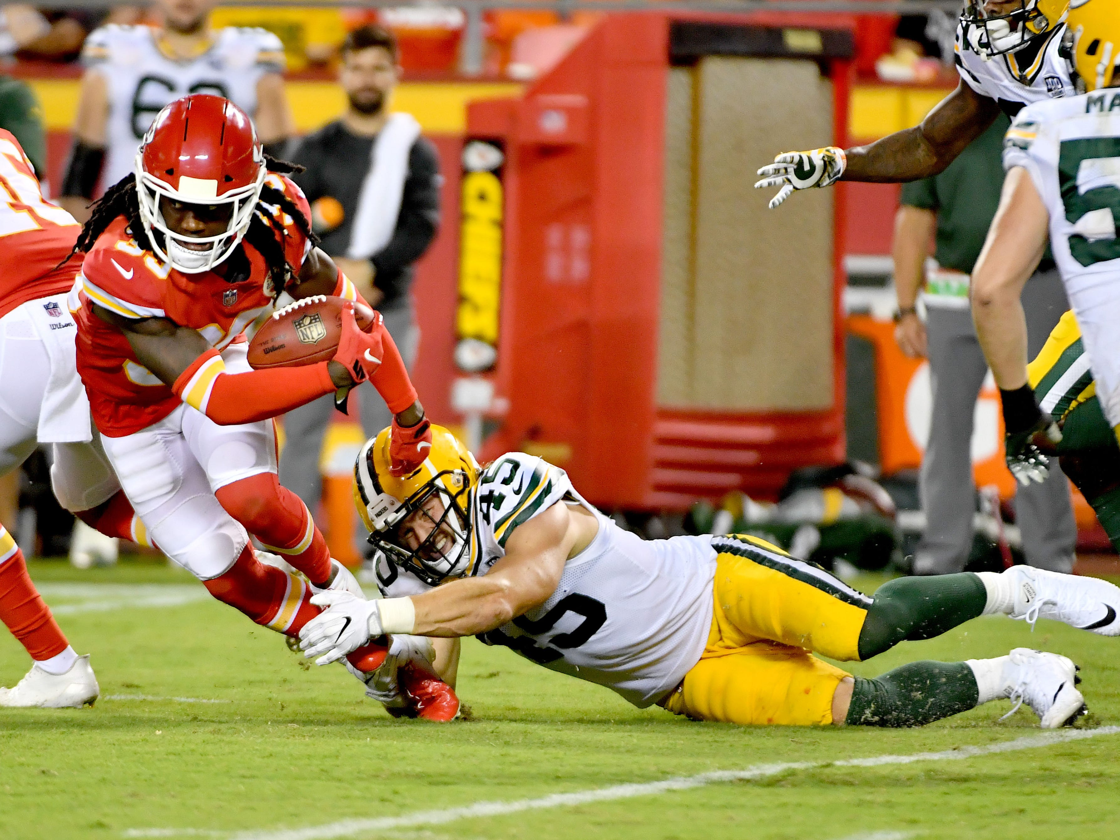 Aug 30, 2018; Kansas City, MO, USA; Kansas City Chiefs defensive back Tremon Smith (39) runs the ball and is tackled by Green Bay Packers linebacker Vince Biegel (45) during the second half at Arrowhead Stadium. Sports