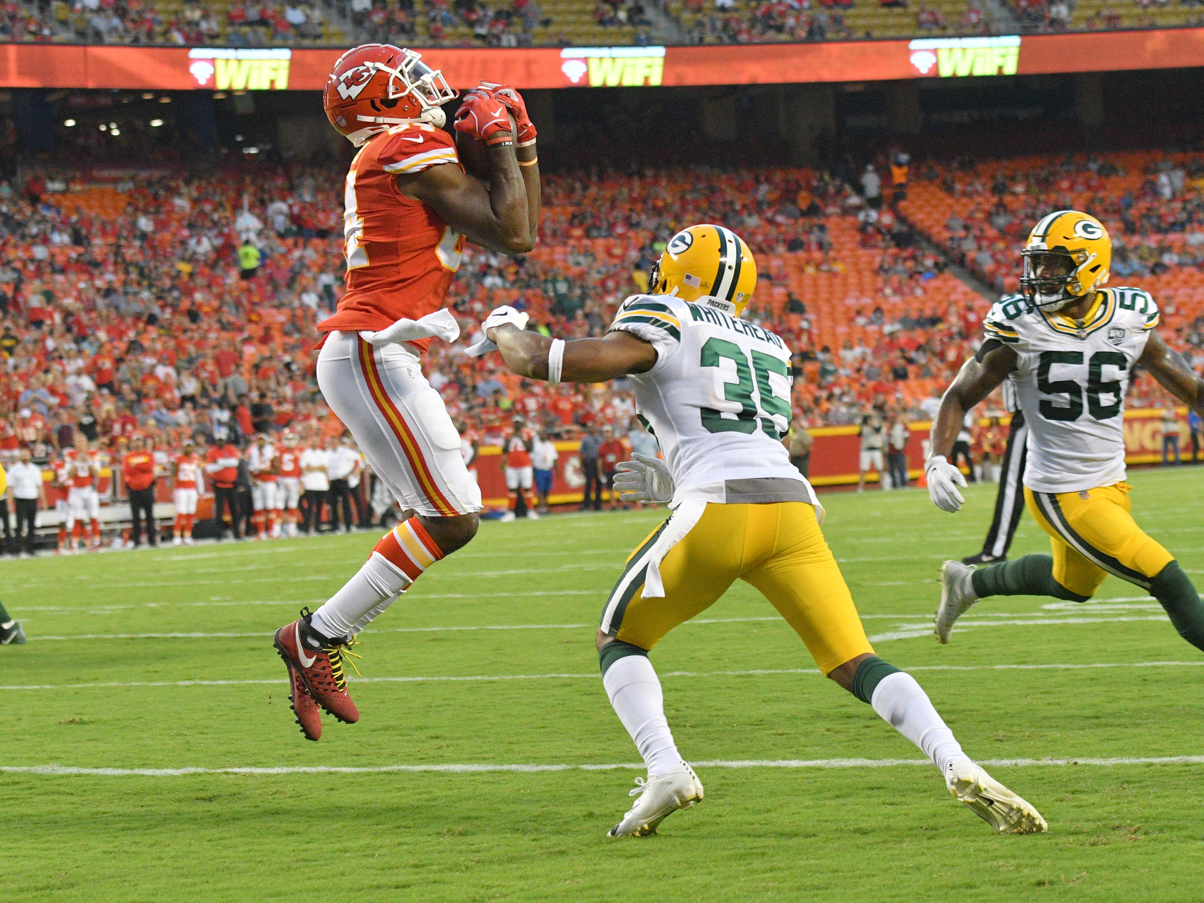 Aug 30, 2018; Kansas City, MO, USA; Kansas City Chiefs tight end Demetrius Harris (84) catches a pass as Green Bay Packers safety Jermaine Whitehead (35) defends during the first half at Arrowhead Stadium.