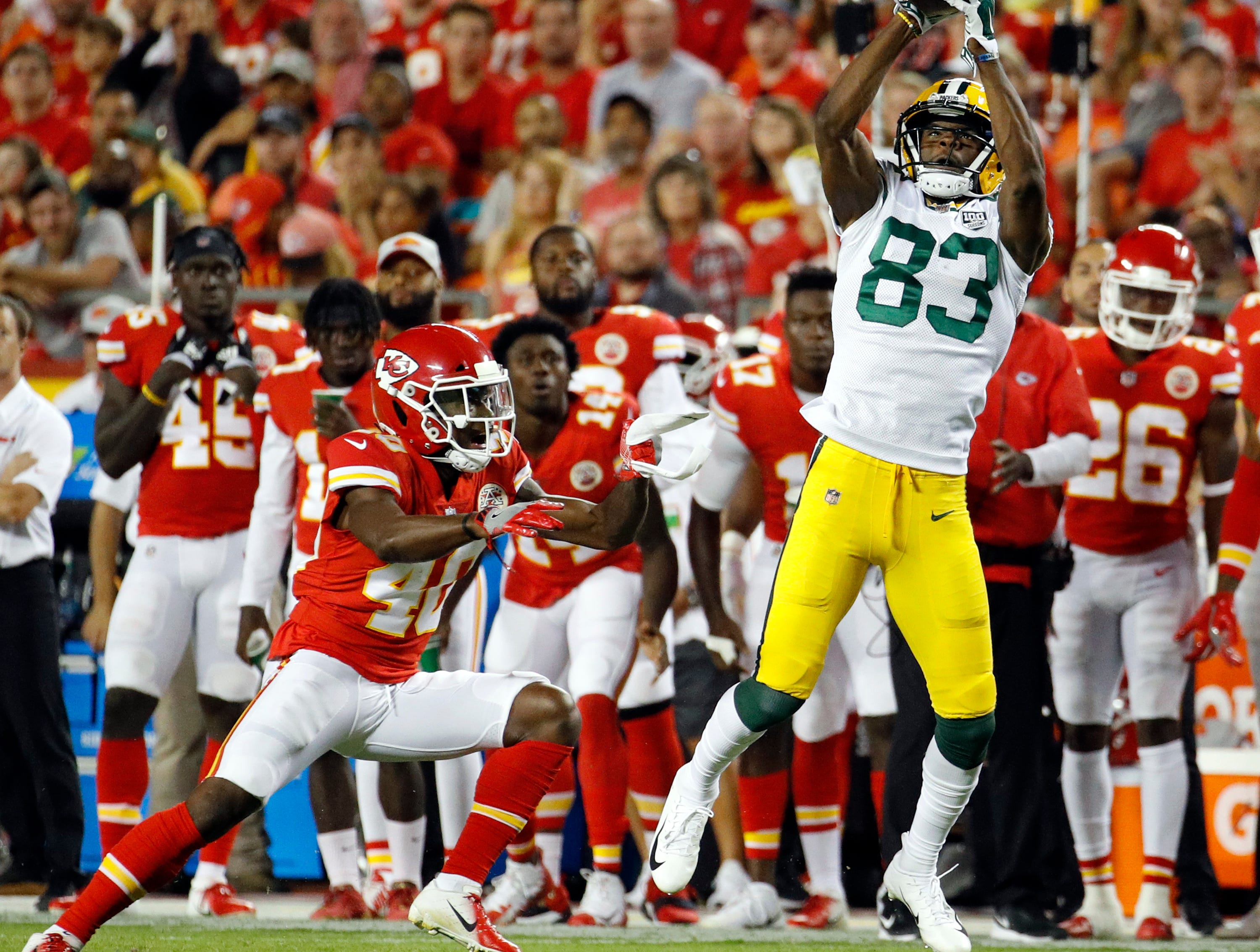 Green Bay Packers wide receiver Marquez Valdes-Scantling (83) makes a catch against Kansas City Chiefs cornerback D'Montre Wade (40) during the first half of an NFL preseason football game in Kansas City, Mo., Thursday, Aug. 30, 2018.