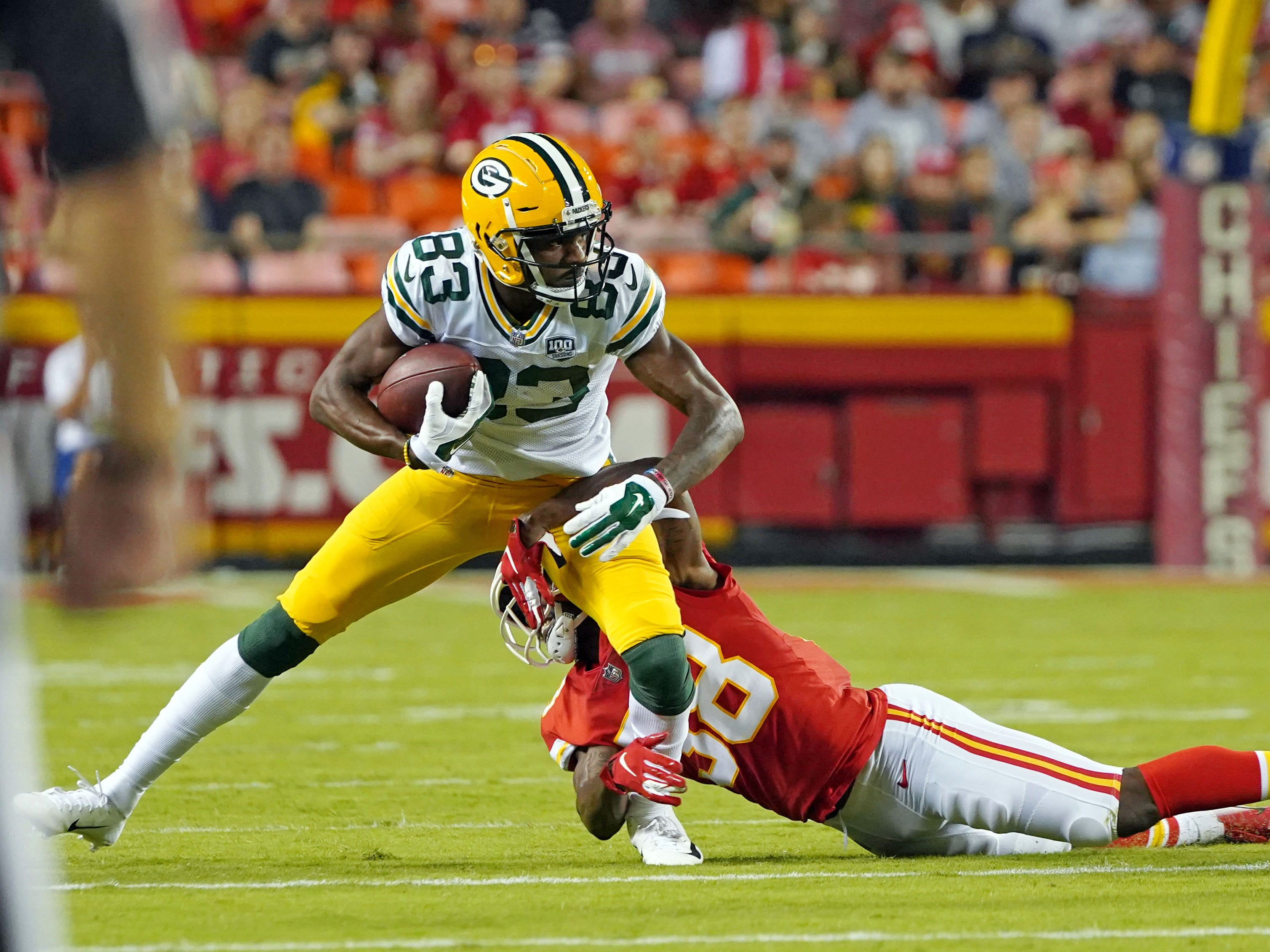 Aug 30, 2018; Kansas City, MO, USA; Green Bay Packers wide receiver Marquez Valdes-Scantling (83) runs against Kansas City Chiefs defensive back Arrion Springs (38) in the first half at Arrowhead Stadium.