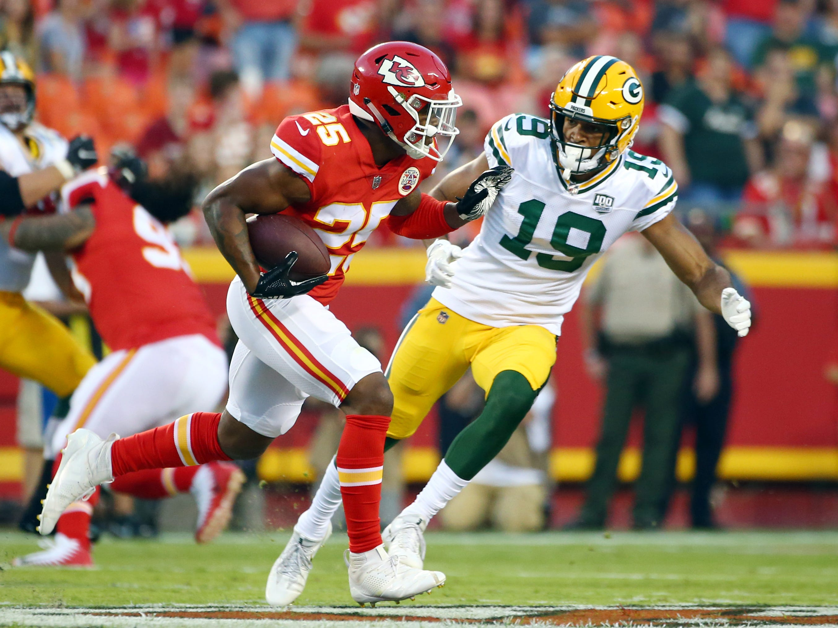 Aug 30, 2018; Kansas City, MO, USA; Kansas City Chiefs defensive back Armani Watts (25) returns an interception as Green Bay Packers wide receiver Equanimeous St. Brown (19) defends in the first half at Arrowhead Stadium.