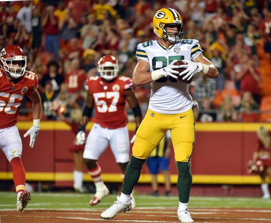 Green Bay Packers tight end Robert Tonyan (85) makes a touchdown catch during the first half of an NFL preseason football game against the Kansas City Chiefs in Kansas City, Mo., Thursday, Aug. 30, 2018.
