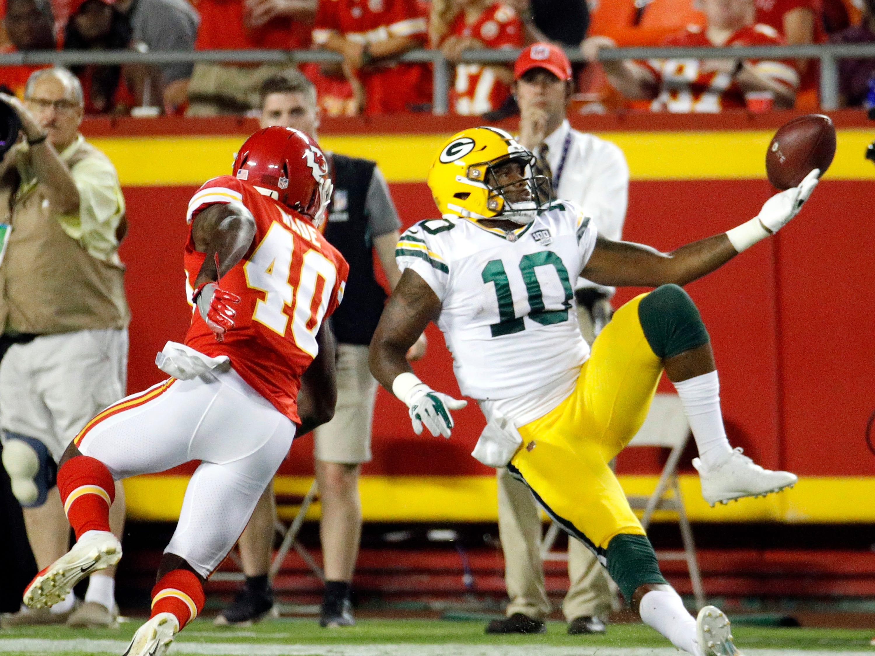 Green Bay Packers wide receiver DeAngelo Yancey (10) can't make the catch as Kansas City Chiefs cornerback D'Montre Wade (40) defends during the first half of an NFL preseason football game in Kansas City, Mo., Thursday, Aug. 30, 2018.