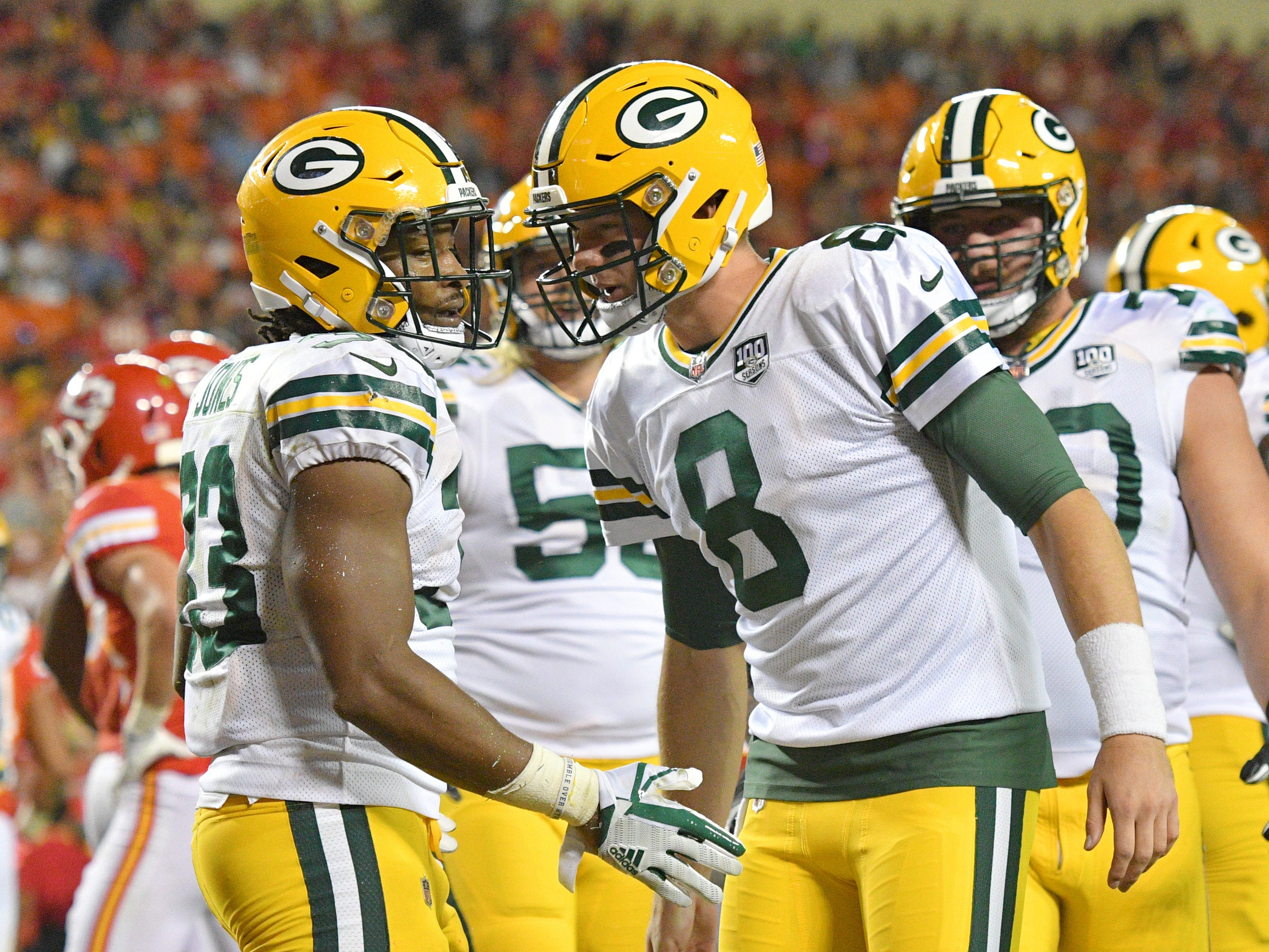 Aug 30, 2018; Kansas City, MO, USA; Green Bay Packers running back Aaron Jones (33) celebrates with quarterback Tim Boyle (8) after scoring during the first half against the Kansas City Chiefs at Arrowhead Stadium.