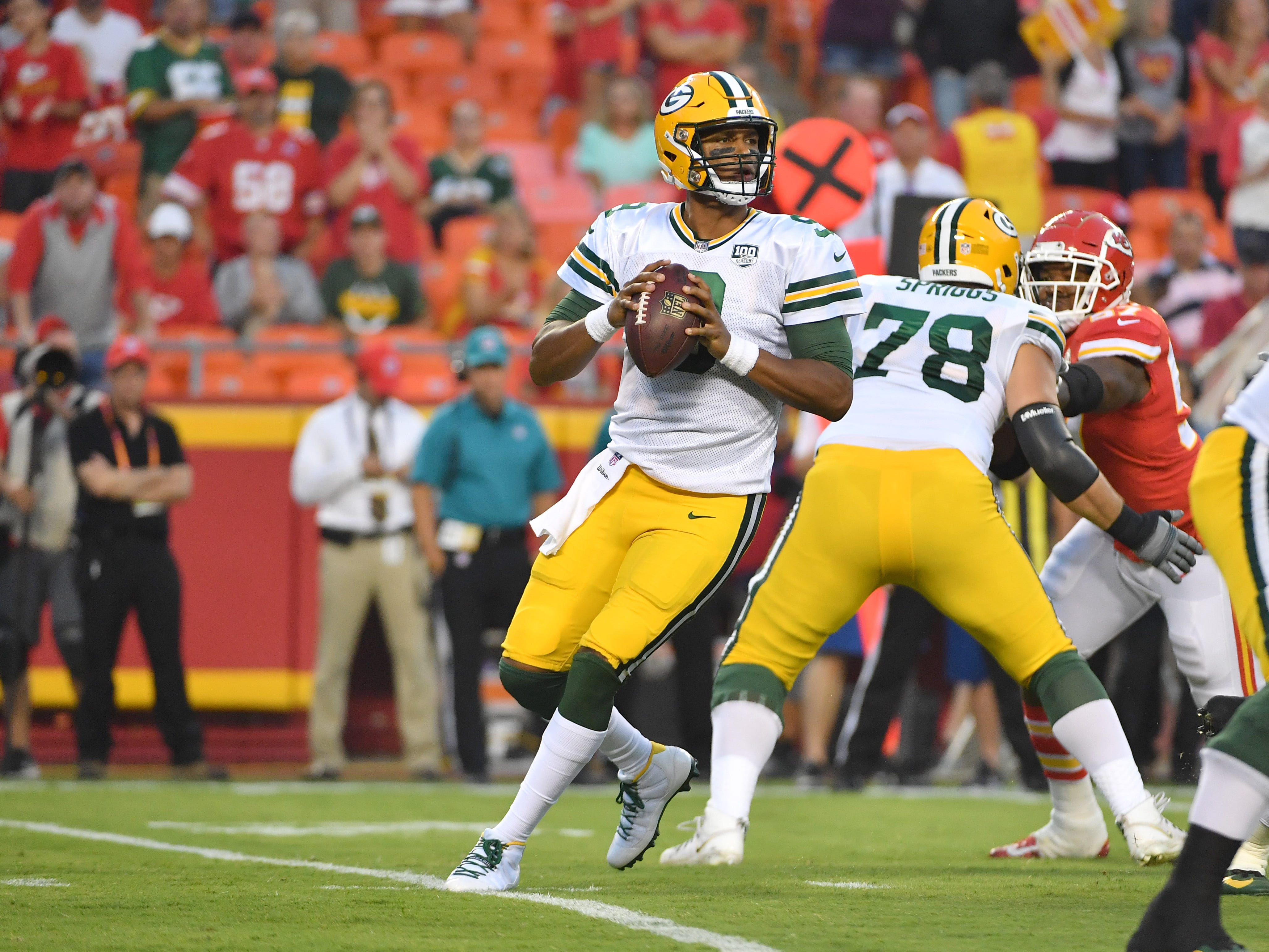 Aug 30, 2018; Kansas City, MO, USA; Green Bay Packers quarterback DeShone Kizer (9) drops back to pass during the first half against the Kansas City Chiefs at Arrowhead Stadium.