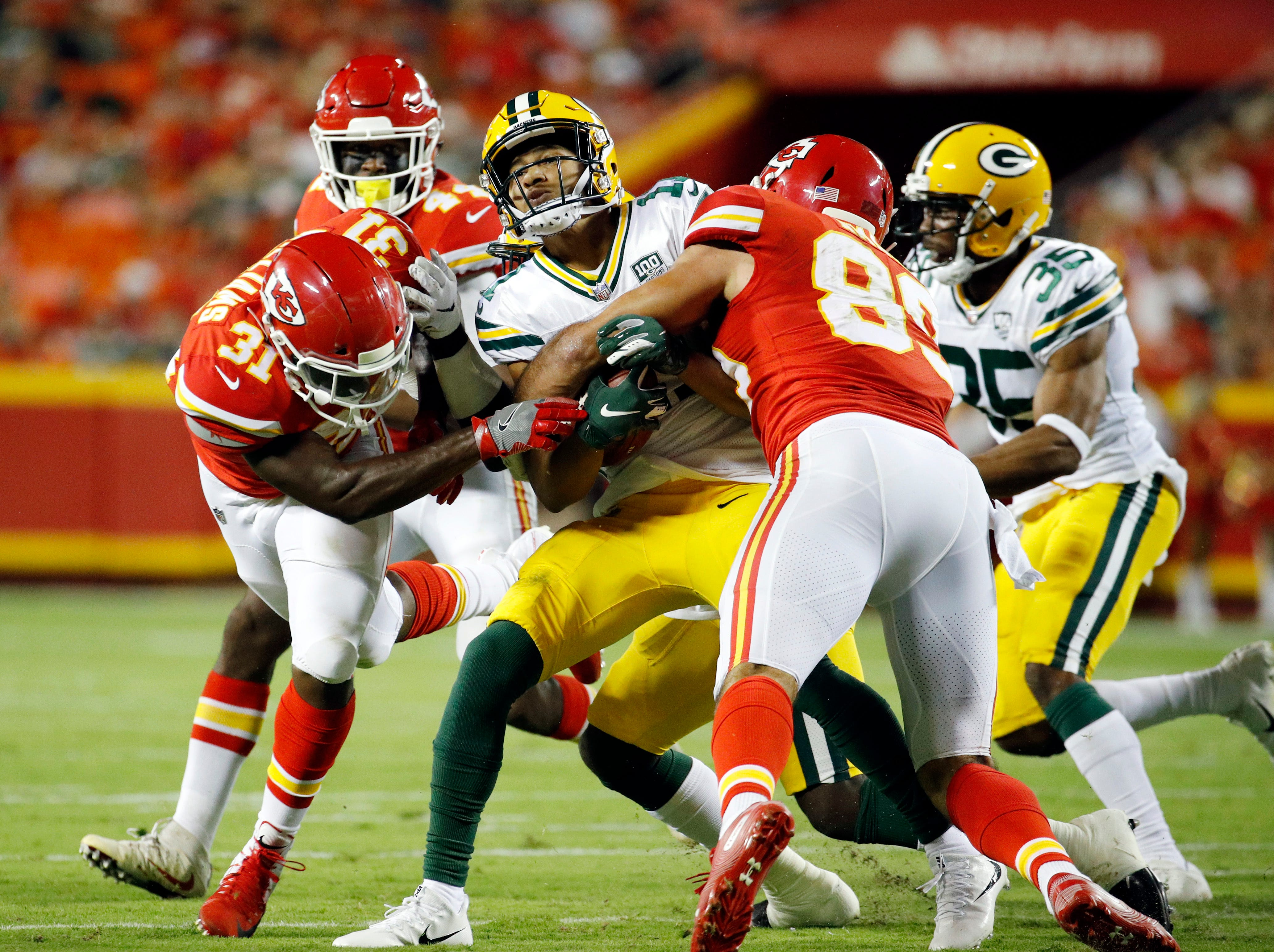 Green Bay Packers wide receiver Trevor Davis, center, is tackled by Kansas City Chiefs running back Darrel Williams (31) and Jace Amaro (89) during the first half of an NFL preseason football game in Kansas City, Mo., Thursday, Aug. 30, 2018.