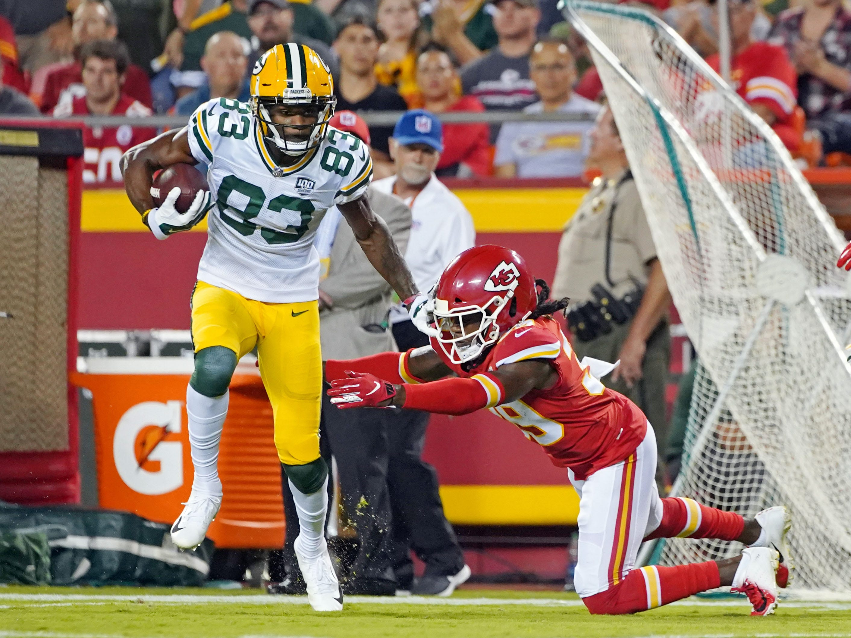 Aug 30, 2018; Kansas City, MO, USA; Green Bay Packers wide receiver Marquez Valdes-Scantling (83) runs against Kansas City Chiefs defensive back Tremon Smith (39) in the first half at Arrowhead Stadium. Sports