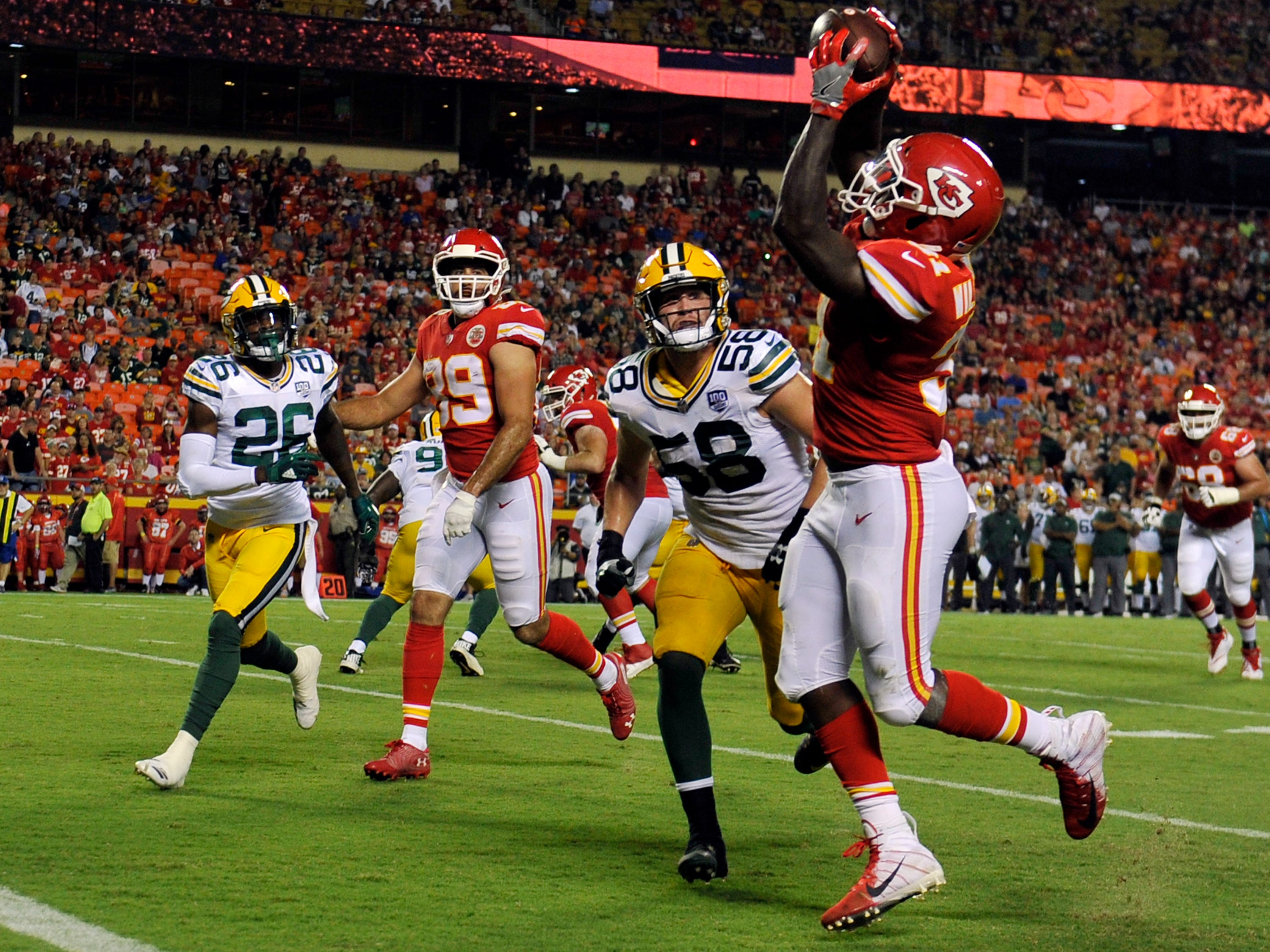 Kansas City Chiefs running back Darrel Williams (31) makes a touchdown catch in front of Green Bay Packers linebacker Greer Martini (58) during the first half of an NFL preseason football game in Kansas City, Mo., Thursday, Aug. 30, 2018.