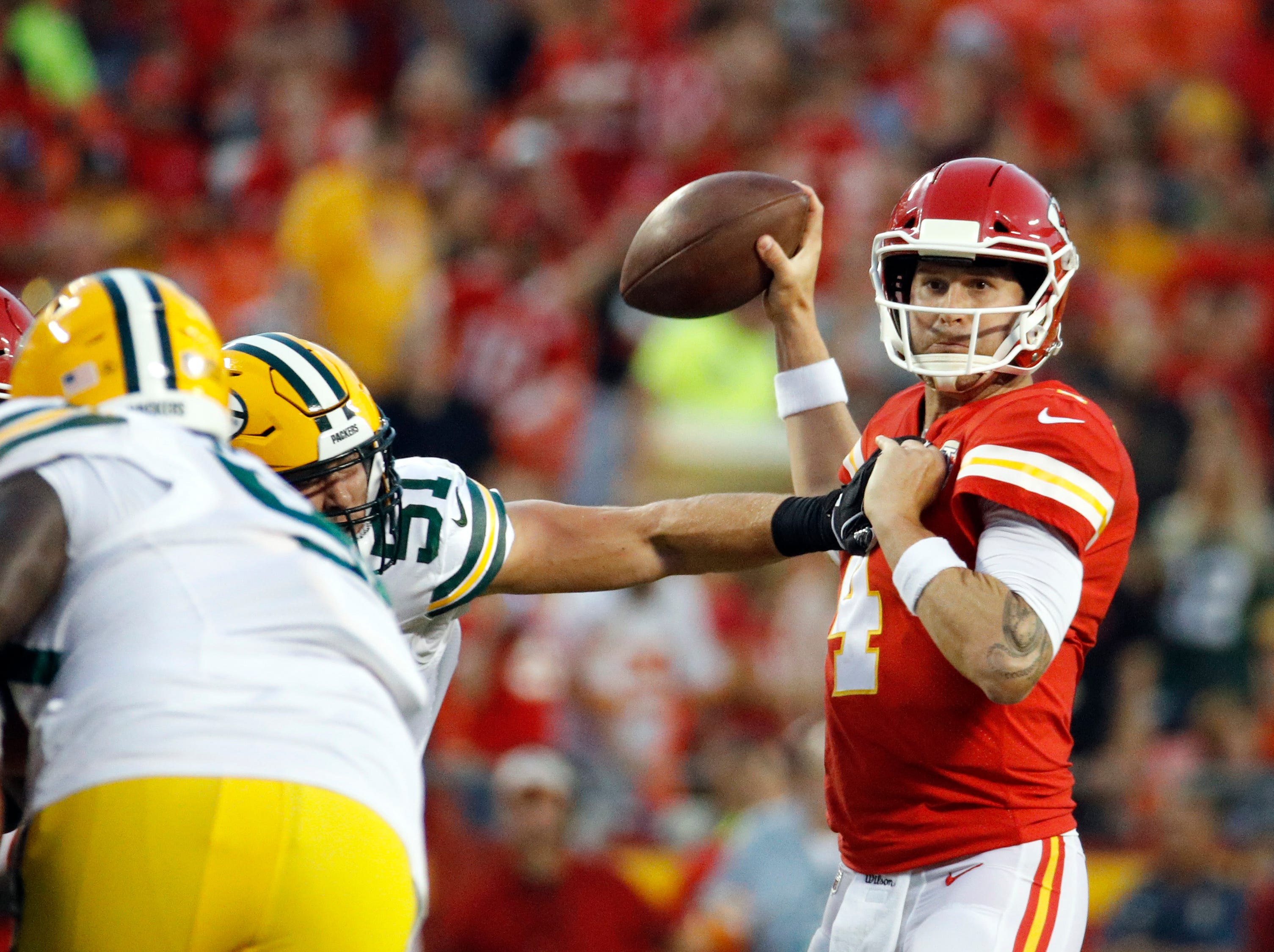 Kansas City Chiefs quarterback Chad Henne (4) throws under pressure from Green Bay Packers linebacker Kyler Fackrell (51) during the first half of an NFL preseason football game in Kansas City, Mo., Thursday, Aug. 30, 2018.