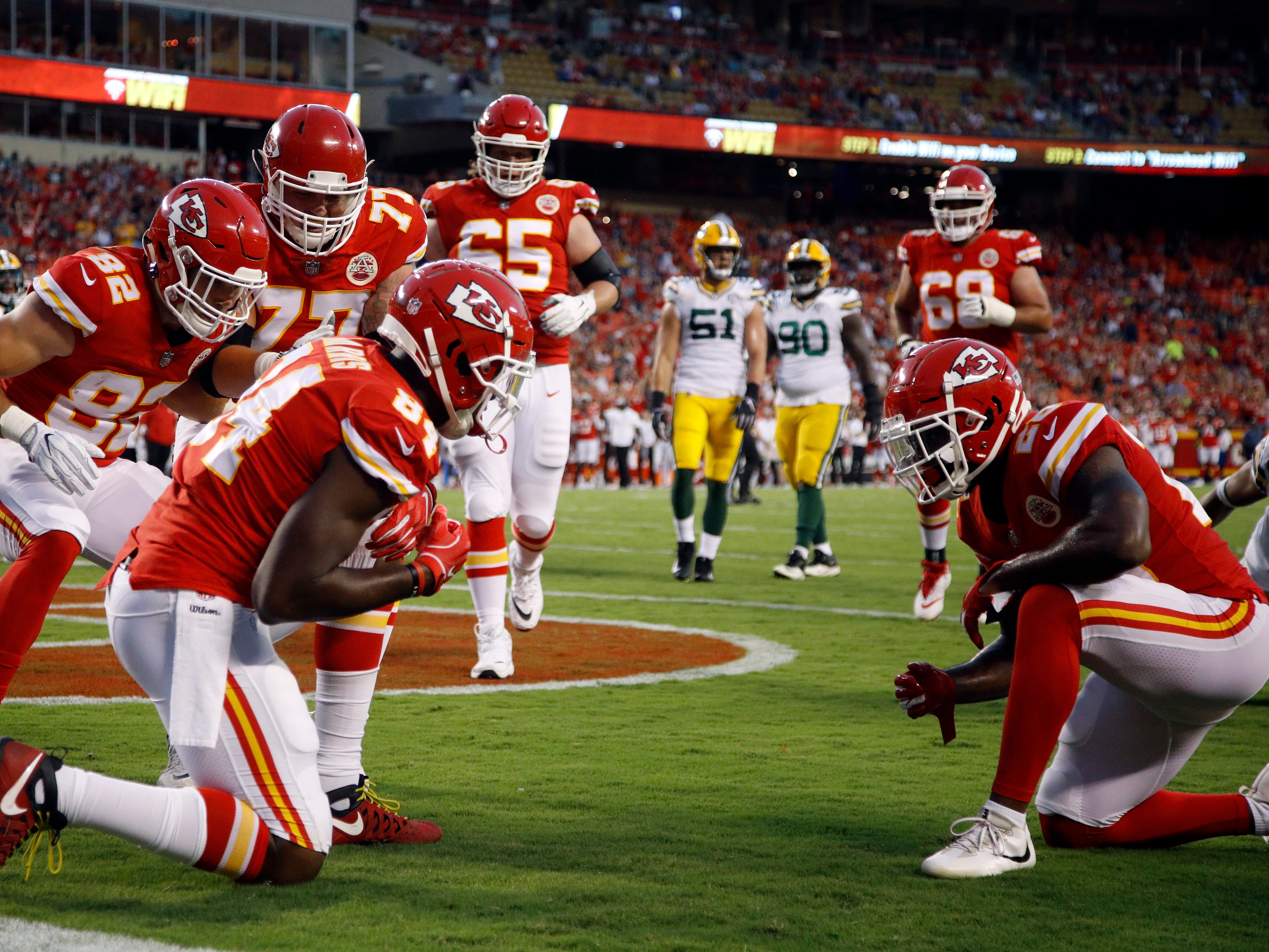 Kansas City Chiefs tight end Demetrius Harris (84) celebrates his touchdown with teammates during the first half of an NFL preseason football game against the Green Bay Packers in Kansas City, Mo., Thursday, Aug. 30, 2018.