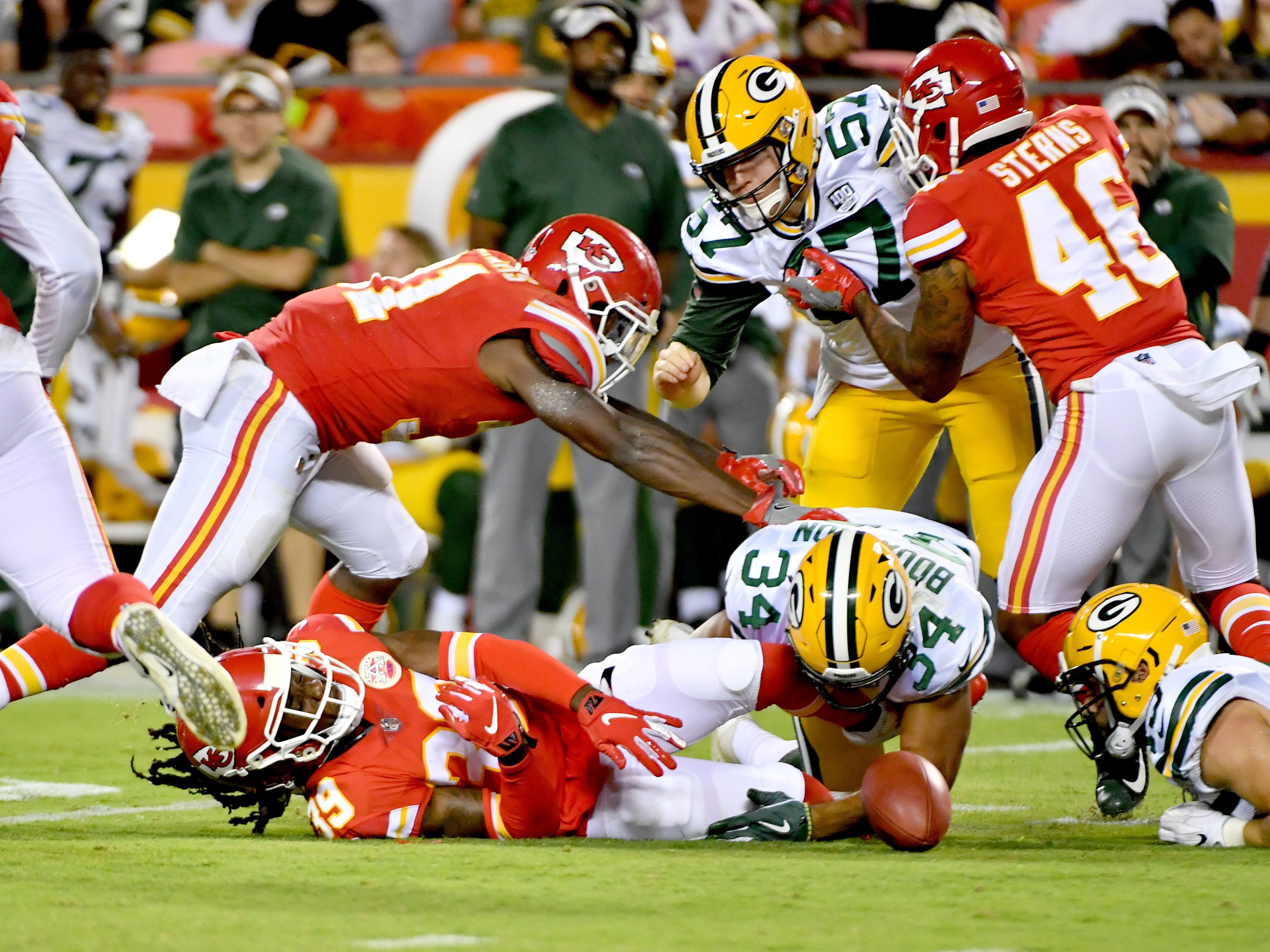 Aug 30, 2018; Kansas City, MO, USA; Kansas City Chiefs defensive back Tremon Smith (39) fumbles the ball as he is tackled by Green Bay Packers linebacker Vince Biegel (45) during the second half at Arrowhead Stadium.
