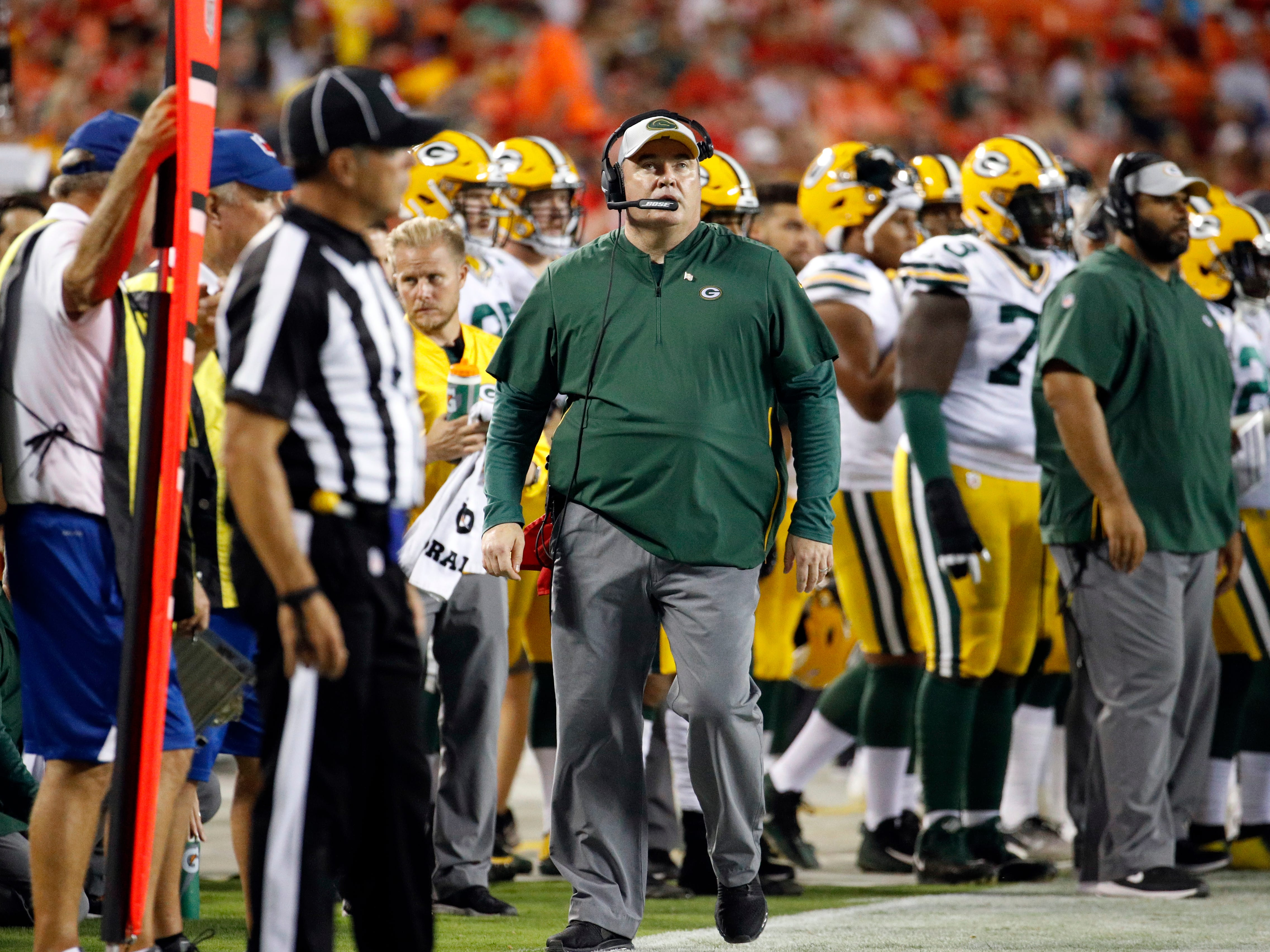 Green Bay Packers head coach Mike McCarthy looks at the score board during the first half of an NFL preseason football game against the Kansas City Chiefs in Kansas City, Mo., Thursday, Aug. 30, 2018.