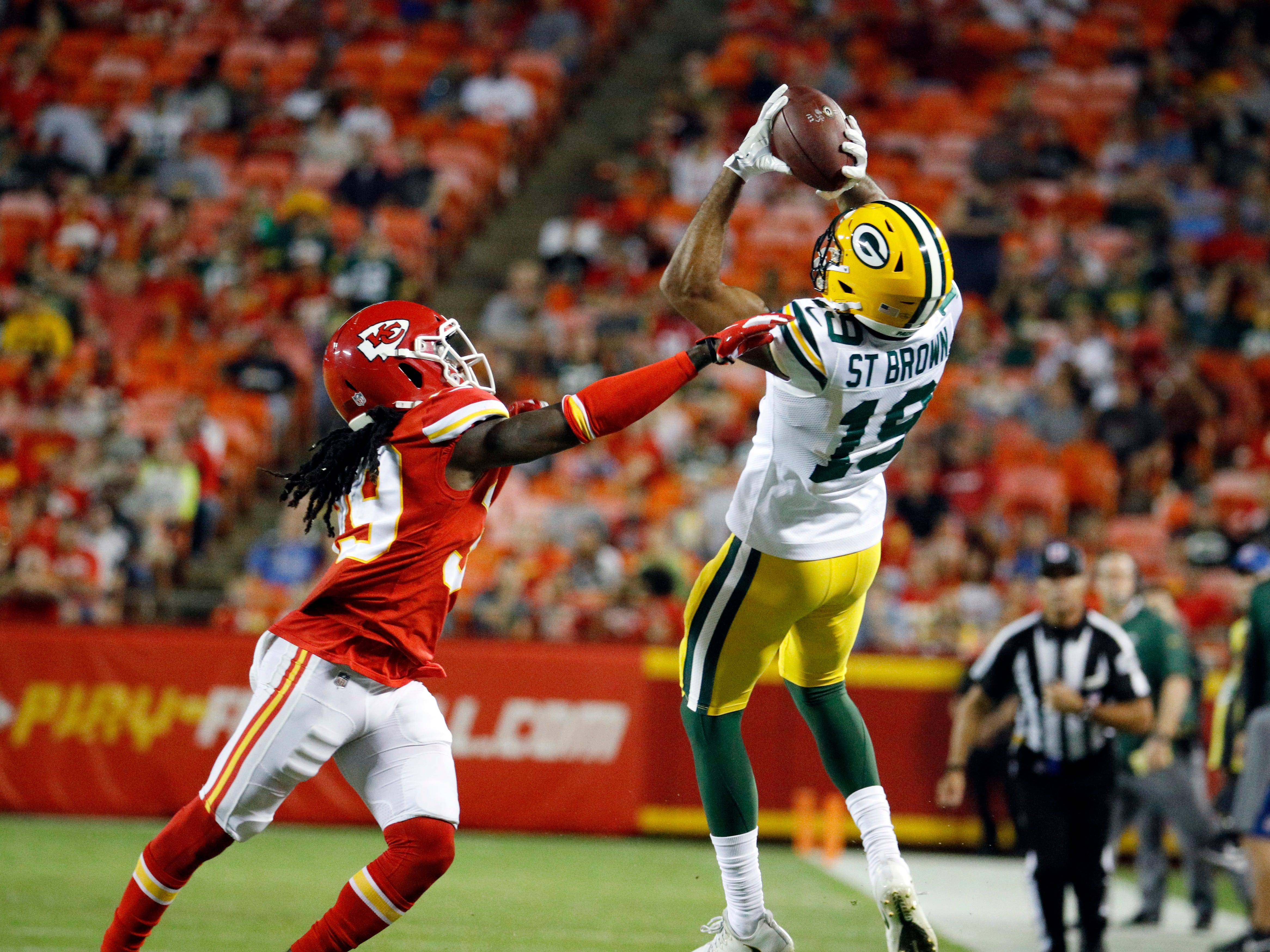 Green Bay Packers wide receiver Equanimeous St. Brown (19) makes a catch over Kansas City Chiefs cornerback Tremon Smith (39) during the first half of an NFL preseason football game in Kansas City, Mo., Thursday, Aug. 30, 2018.