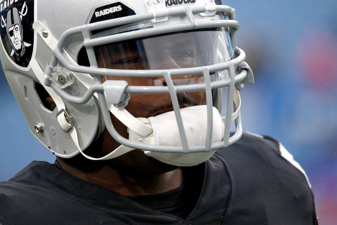 Oakland Raiders defensive end Khalil Mack works out prior to an NFL football game against the Buffalo Bills, Sunday, Oct. 29, 2017, in Orchard Park, N.Y. (AP Photo/Jeffrey T. Barnes)