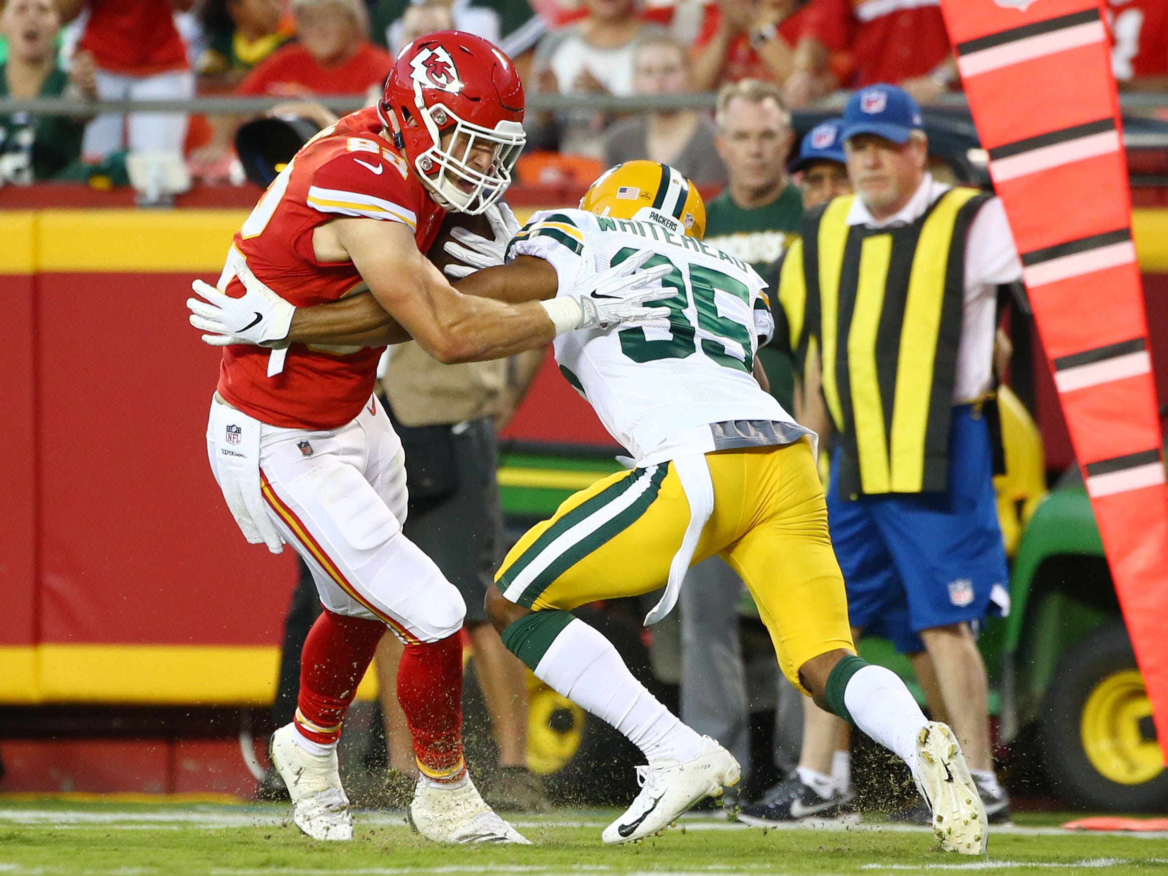 Aug 30, 2018; Kansas City, MO, USA; Kansas City Chiefs tight end Alex Ellis (82) evades Green Bay Packers safety Jermaine Whitehead (35) in the first half at Arrowhead Stadium. Sports
