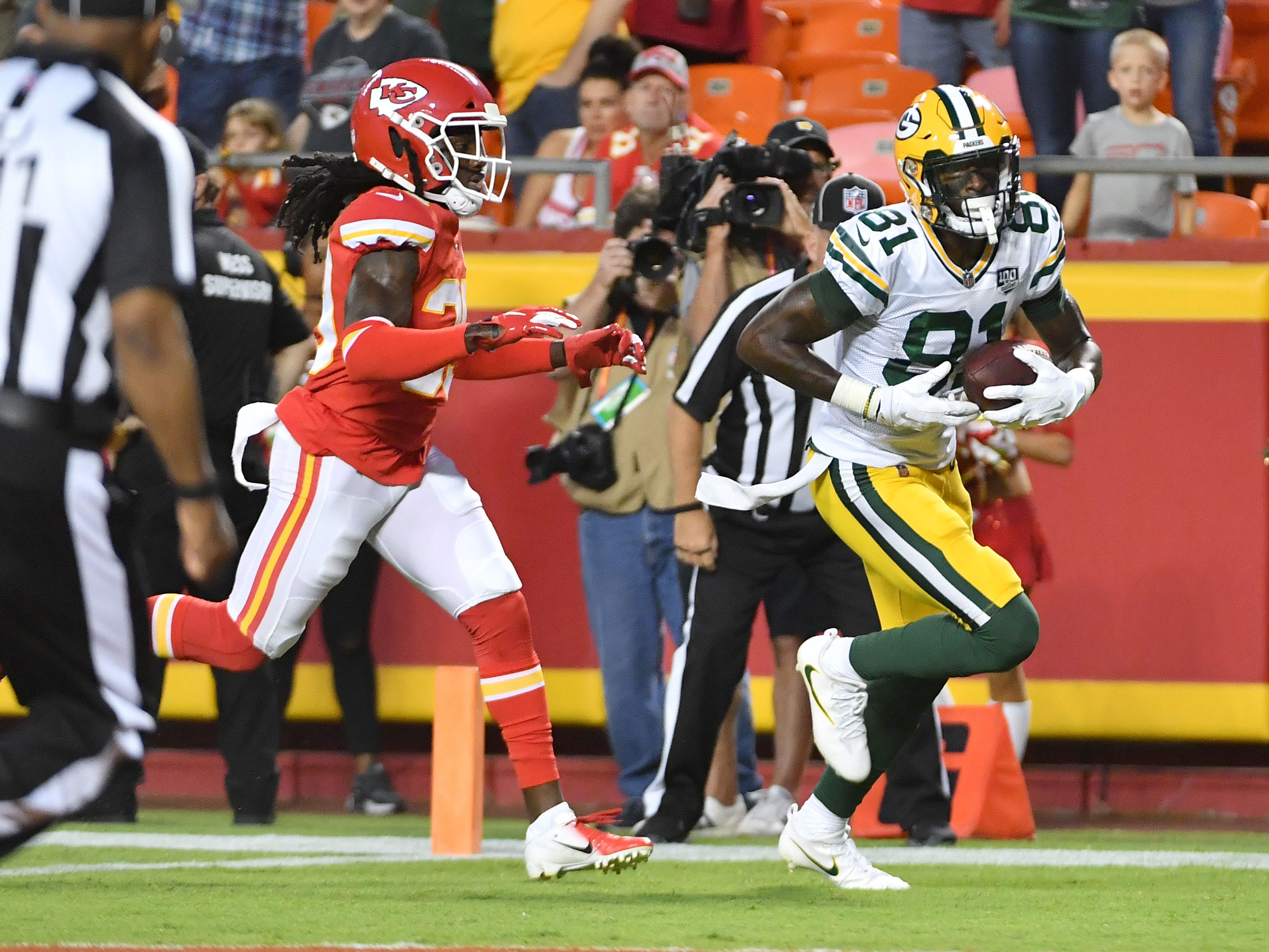 Aug 30, 2018; Kansas City, MO, USA; Green Bay Packers wide receiver Geronimo Allison (81) scores a touchdown as Kansas City Chiefs defensive back Tremon Smith (39) chases during the first half at Arrowhead Stadium.