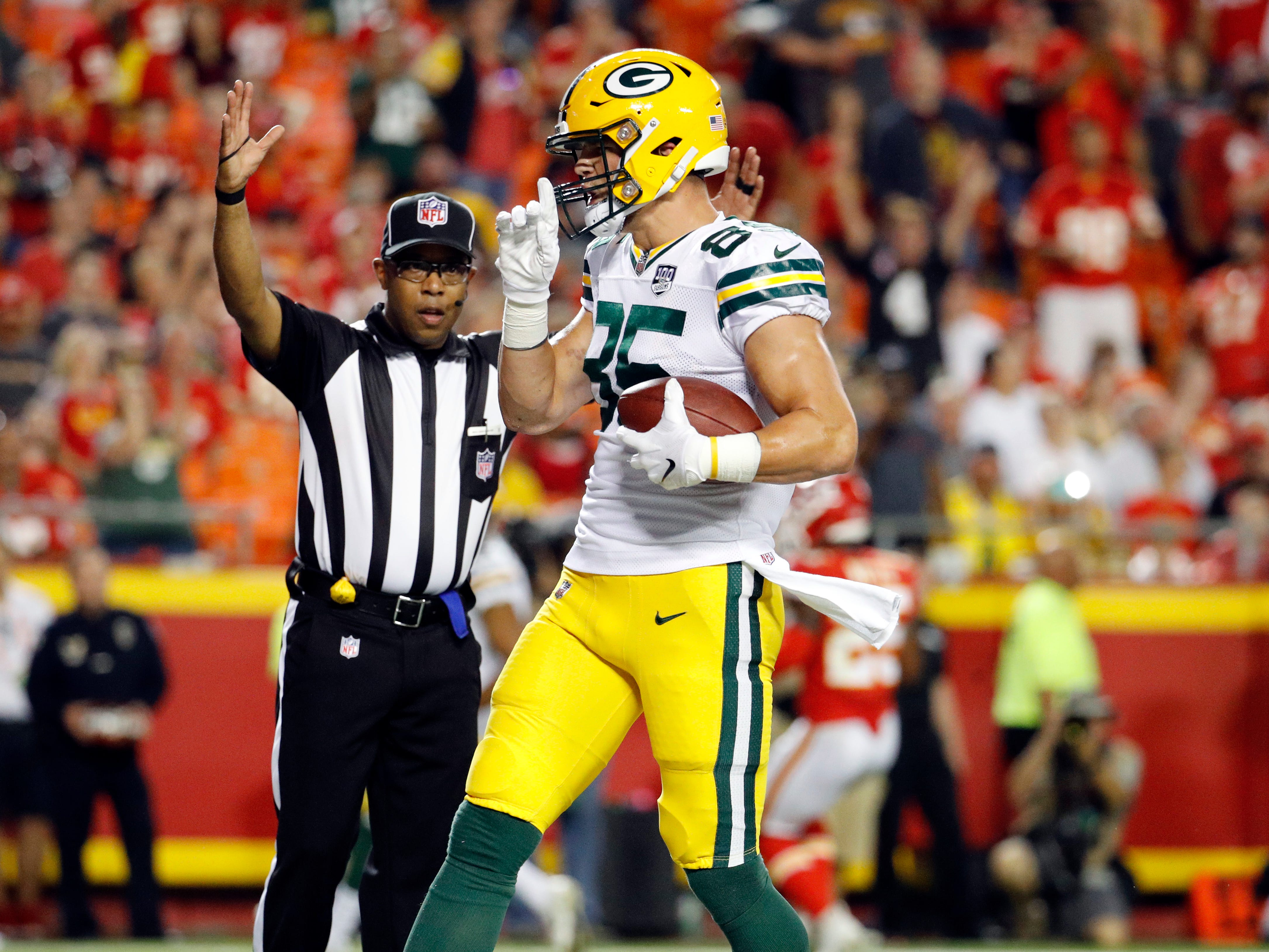 Green Bay Packers tight end Robert Tonyan (85) celebrates his touchdown during the first half of an NFL preseason football game against the Kansas City Chiefs in Kansas City, Mo., Thursday, Aug. 30, 2018.