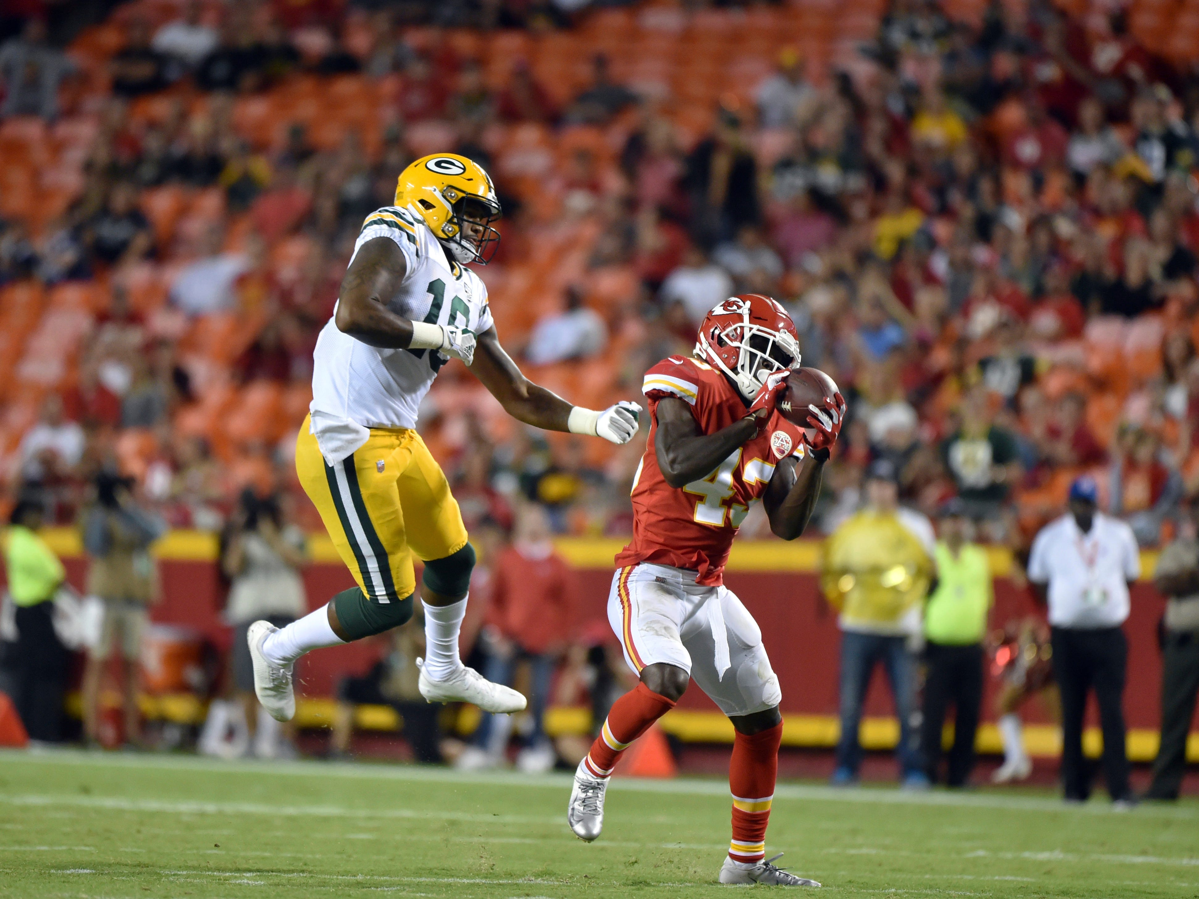 Kansas City Chiefs cornerback Makinton Dorleant (43) intercepts a pass intended for Green Bay Packers wide receiver DeAngelo Yancey (10), and runs for a touchdown, during the second half of an NFL preseason football game in Kansas City, Mo., Thursday, Aug. 30, 2018.