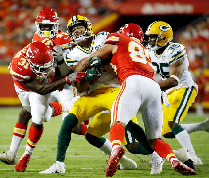 Green Bay Packers' Trevor Davis, center, is tackled by Kansas City Chiefs' Darrel Williams (31) and Jace Amaro on a kickoff return during the first half of an NFL preseason football game in Kansas City, Mo., Thursday, Aug. 30, 2018.