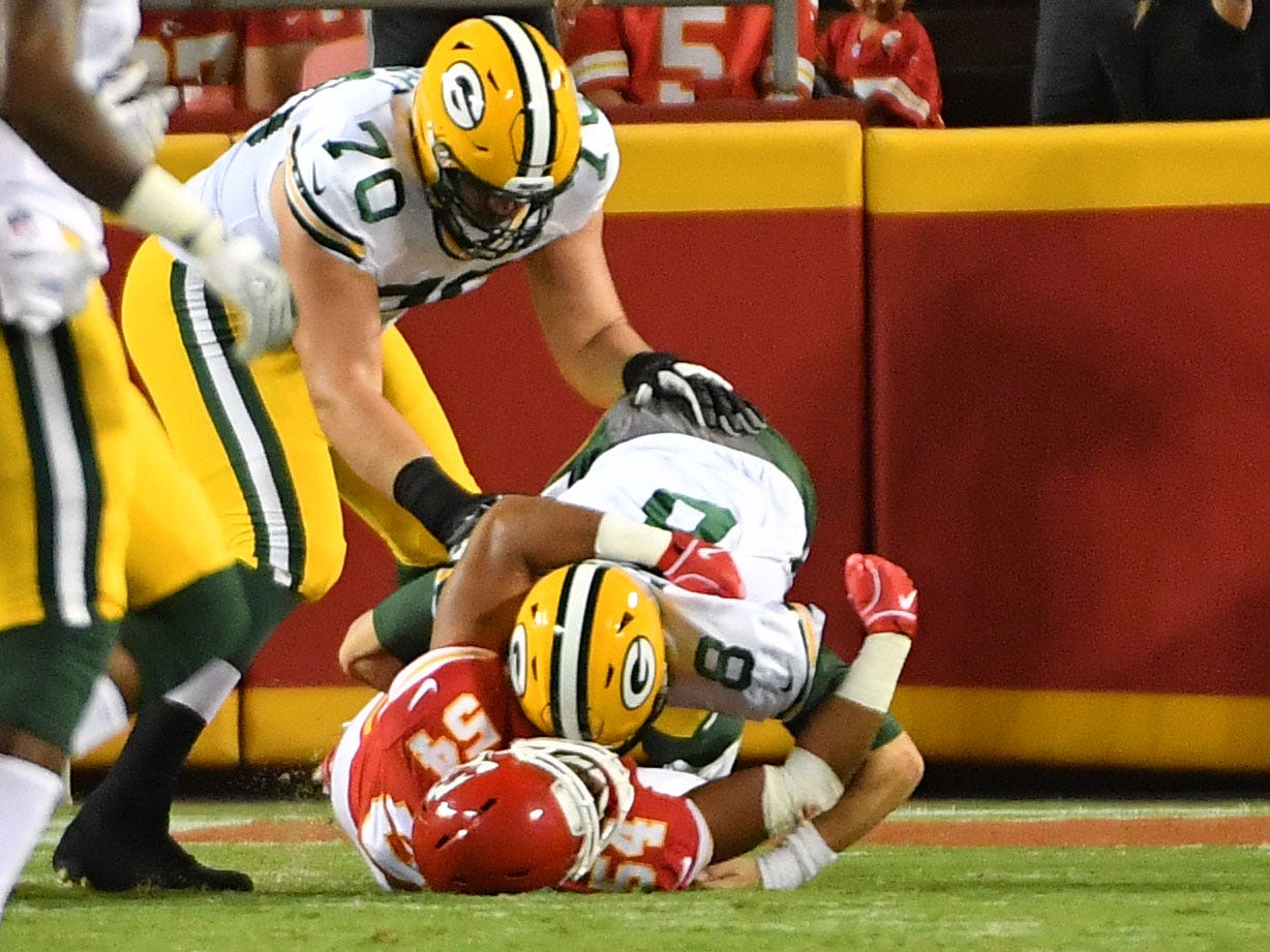 Aug 30, 2018; Kansas City, MO, USA; Green Bay Packers quarterback Tim Boyle (8) is sacked by Kansas City Chiefs linebacker Tyrone Holmes (54) during the first half at Arrowhead Stadium.