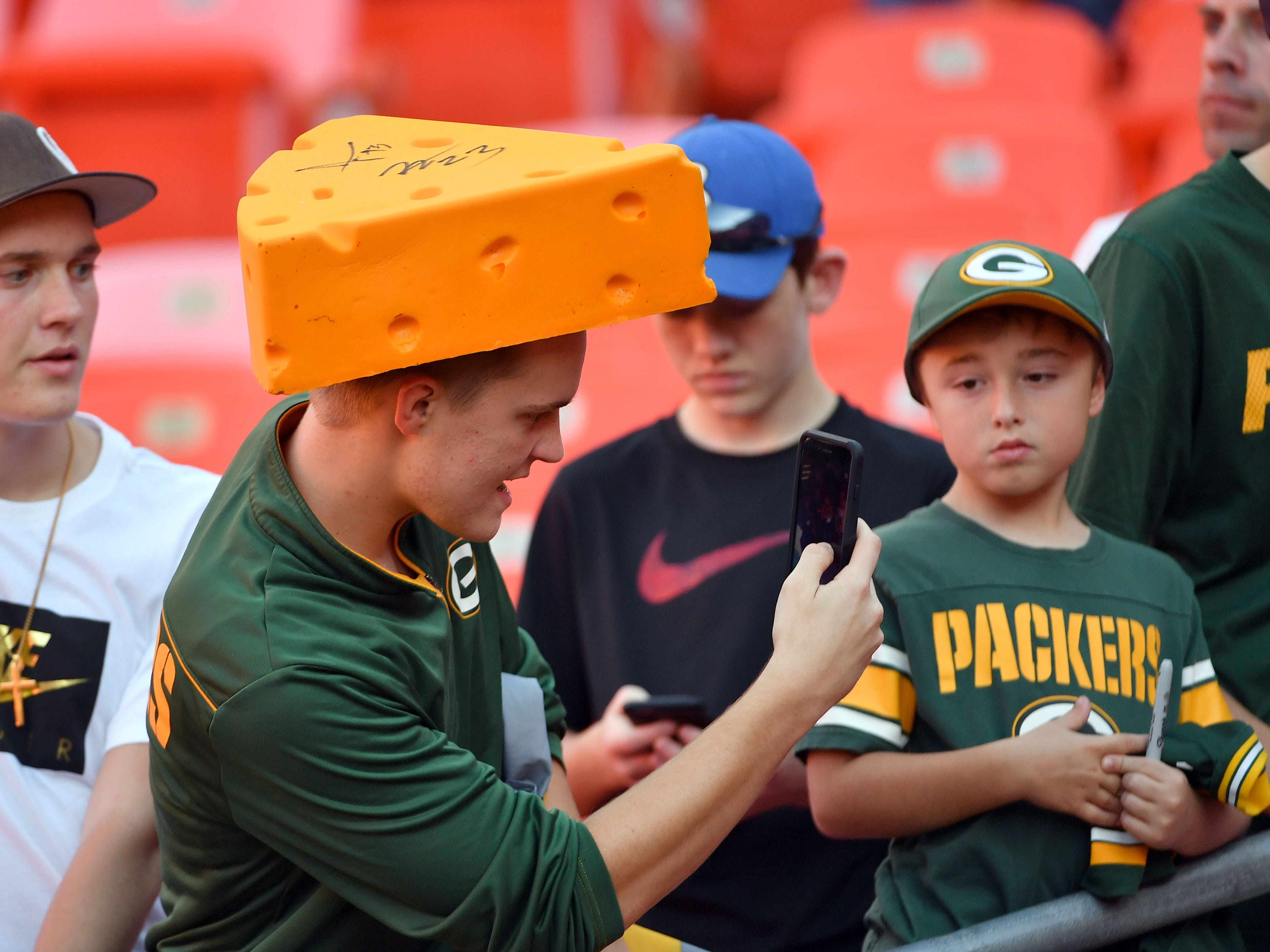 Aug 30, 2018; Kansas City, MO, USA; Green Bay Packers fans take selfies before the game against the Kansas City Chiefs at Arrowhead Stadium.