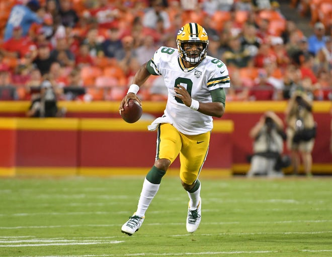 Aug 30, 2018; Kansas City, MO, USA; Green Bay Packers quarterback DeShone Kizer (9) scrambles with the ball during the first half against the Kansas City Chiefs at Arrowhead Stadium.