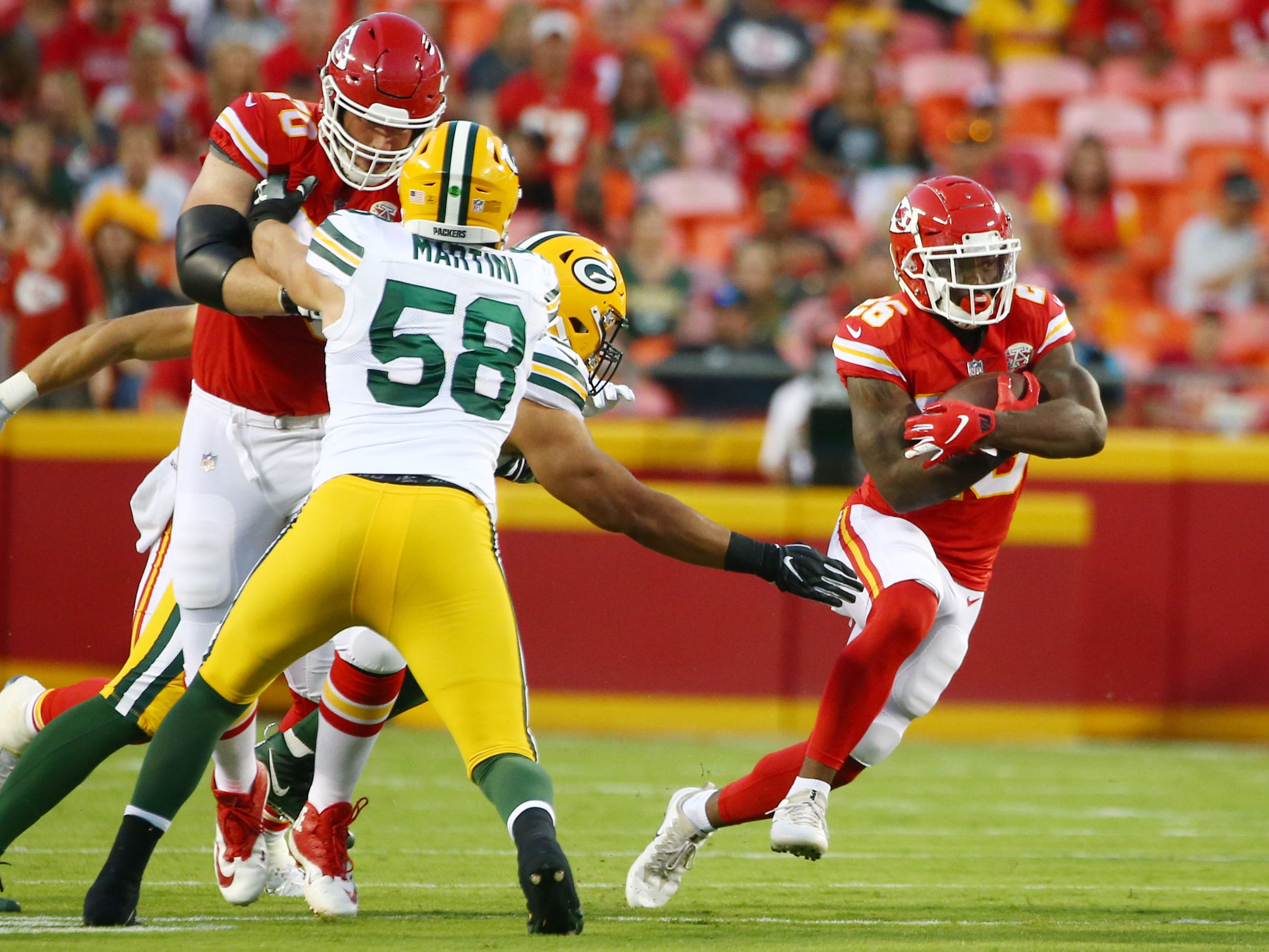 Aug 30, 2018; Kansas City, MO, USA; Kansas City Chiefs running back Damien Williams (26) runs against the Green Bay Packers in the first half at Arrowhead Stadium.