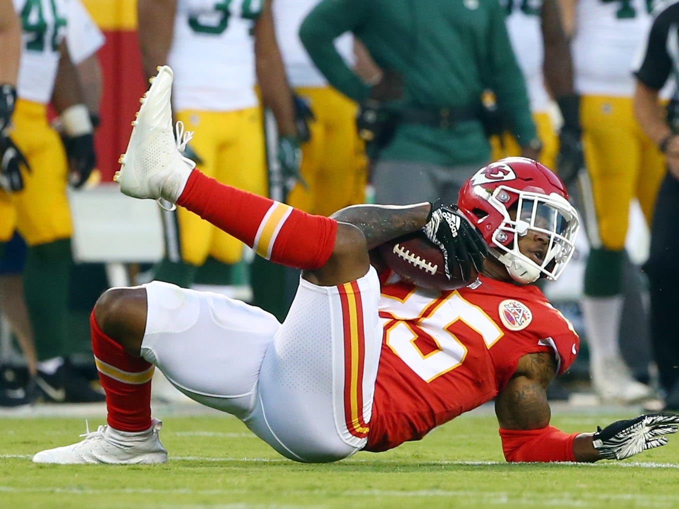 Aug 30, 2018; Kansas City, MO, USA; Kansas City Chiefs defensive back Armani Watts (25) intercepts a pass against the Green Bay Packers in the first half at Arrowhead Stadium.