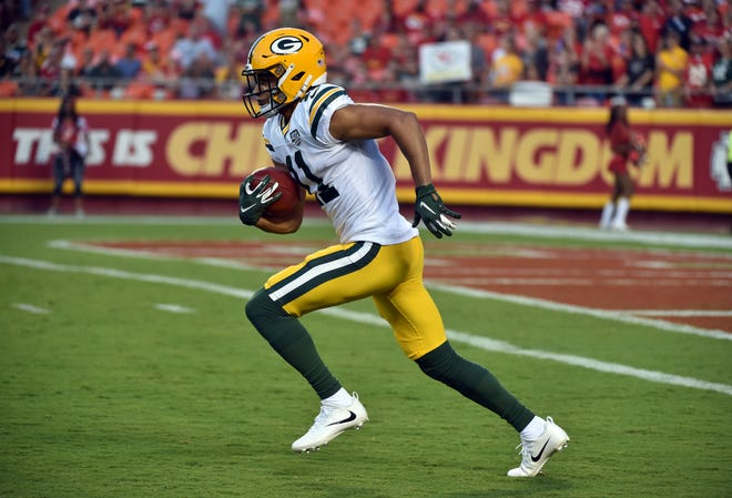 Green Bay Packers wide receiver Trevor Davis (11) returns a kickoff during the first half of an NFL preseason football game against the Kansas City Chiefs in Kansas City, Mo., Thursday, Aug. 30, 2018.