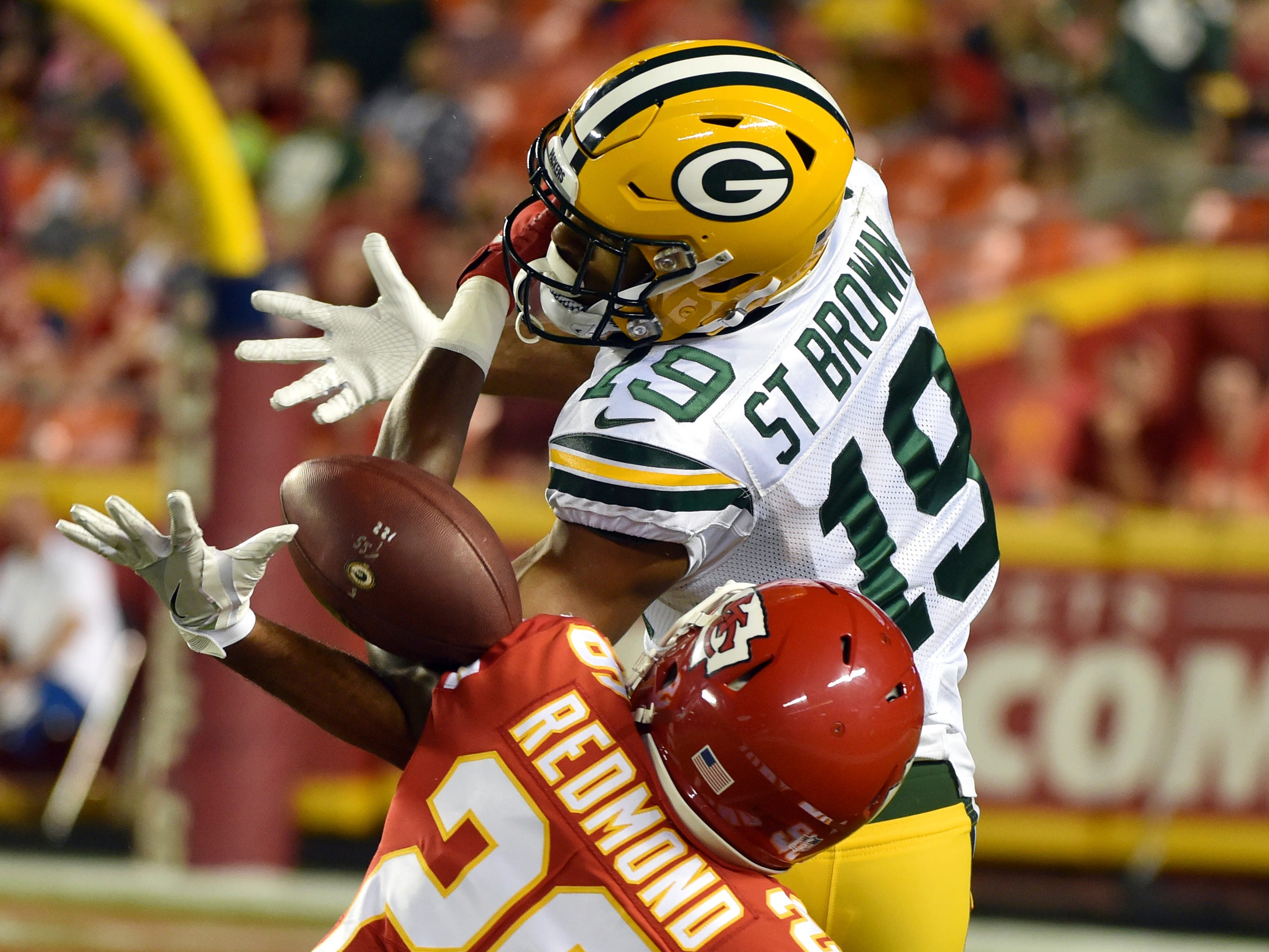 Kansas City Chiefs cornerback Will Redmond (26) breaks up a pass intended for Green Bay Packers wide receiver Equanimeous St. Brown (19) during the first half of an NFL preseason football game in Kansas City, Mo., Thursday, Aug. 30, 2018.