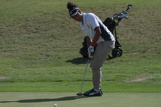 Madyson Hampton, one of two of Palm Springs High School's girls golfers  putts in a game against Xavier Prep at Indian Canyons Golf Resort, Palm Springs, Calif., Thursday, August 30, 2018.