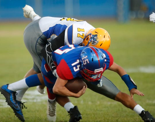 Indio High School's Isaiah Ocampo is stopped short of gain against Brawley High School on August 30, 2018.