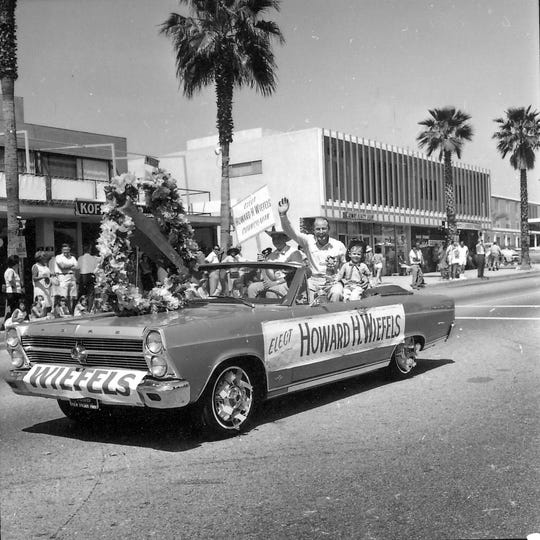 Howard Wiefels riding in Desert Circus parade.