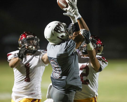 Ethan Acuna of Rancho Mirage nearly comes up with a catch in the end zone before Colton picked it off, August 30, 2018.