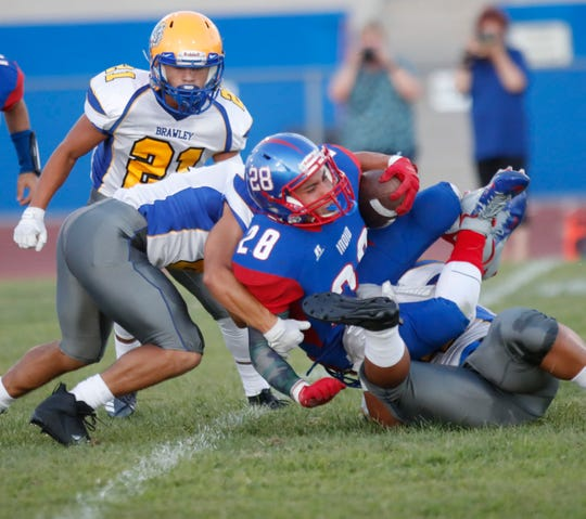 Indio High School's Joshua Paez is stopped short of gain against Brawley High School on August 30, 2018.