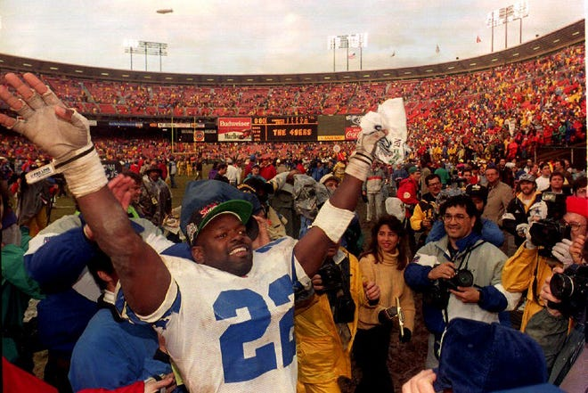 SAN FRANCISCO, CA - JANUARY 17:  Dallas Cowboys running back Emmitt Smith reacts at Candlestick Park 17 January, 1993 after their victory in the NFC Championship against the San Francisco 49er's in San Francisco, CA. The Cowboys won 30-20 and will meet the Buffalo Bills in Super Bowl XXVII.  (Photo credit should read ALEX GARCIA/AFP/Getty Images)