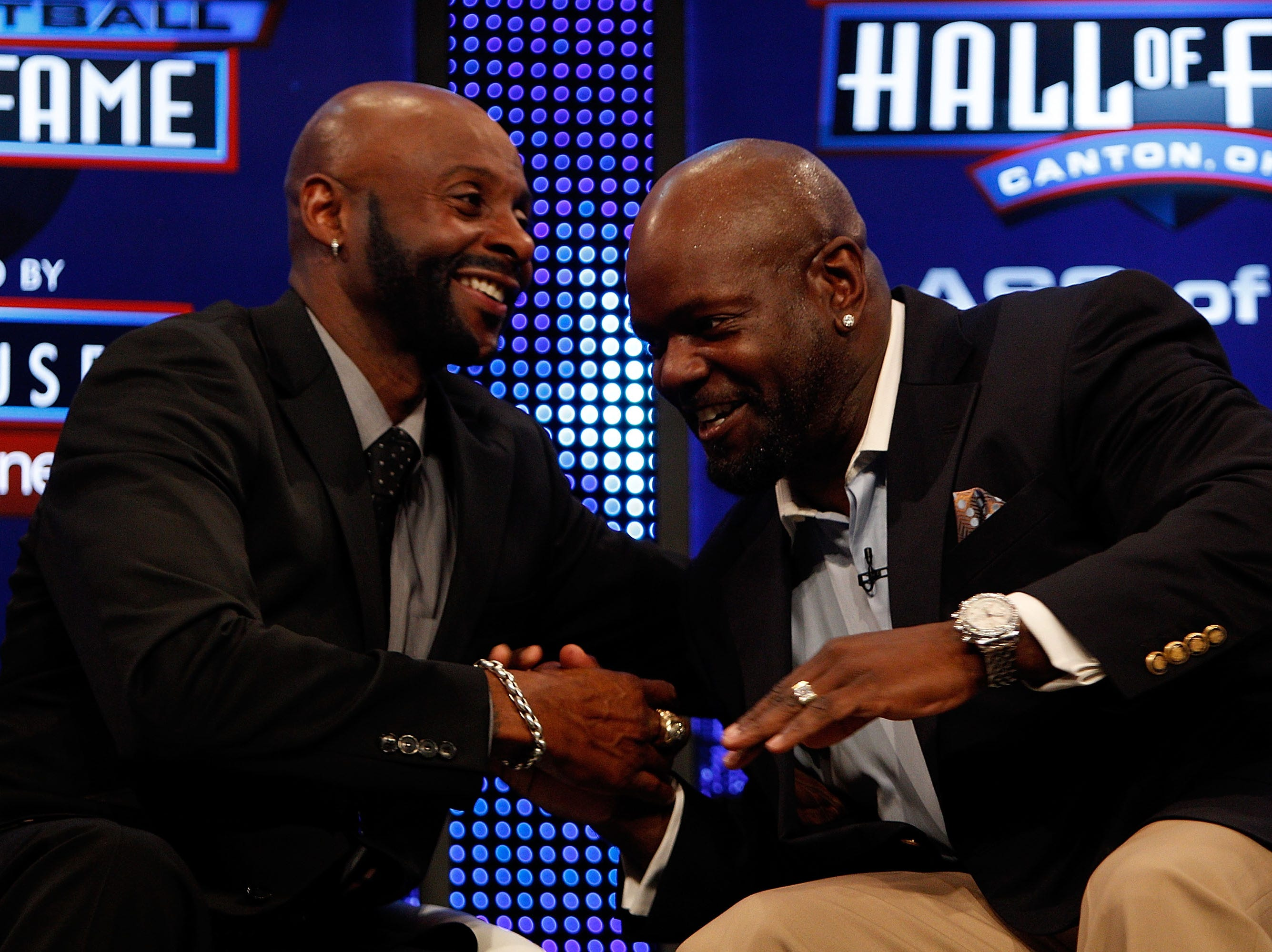 FORT LAUDERDALE, FL - FEBRUARY 06:  (L-R) Jerry Rice and Emmitt Smith talk on stage after they were both announced as two of the newest enshrinees into the Hall of Fame during the Pro Football Hall of Fame Class of 2010 Press Conference held at the Greater Ft. Lauderdale/Broward County Convention Center as part of media week for Super Bowl XLIV on February 6, 2010 in Fort Lauderdale, Florida.  (Photo by Chris Graythen/Getty Images)